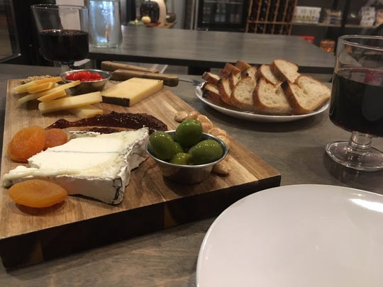 The bounty that is the 3 Cheese Combo board at Share: Cheesebar in Pleasant Ridge, accompanied by glasses of Rioja