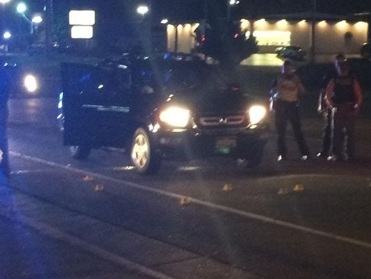 Eight yellow markers show were shots were fired after a minor fender bender on Wilma Rudolph Boulevard in this photo taken by The Leaf-Chronicle on July 2, 2015.