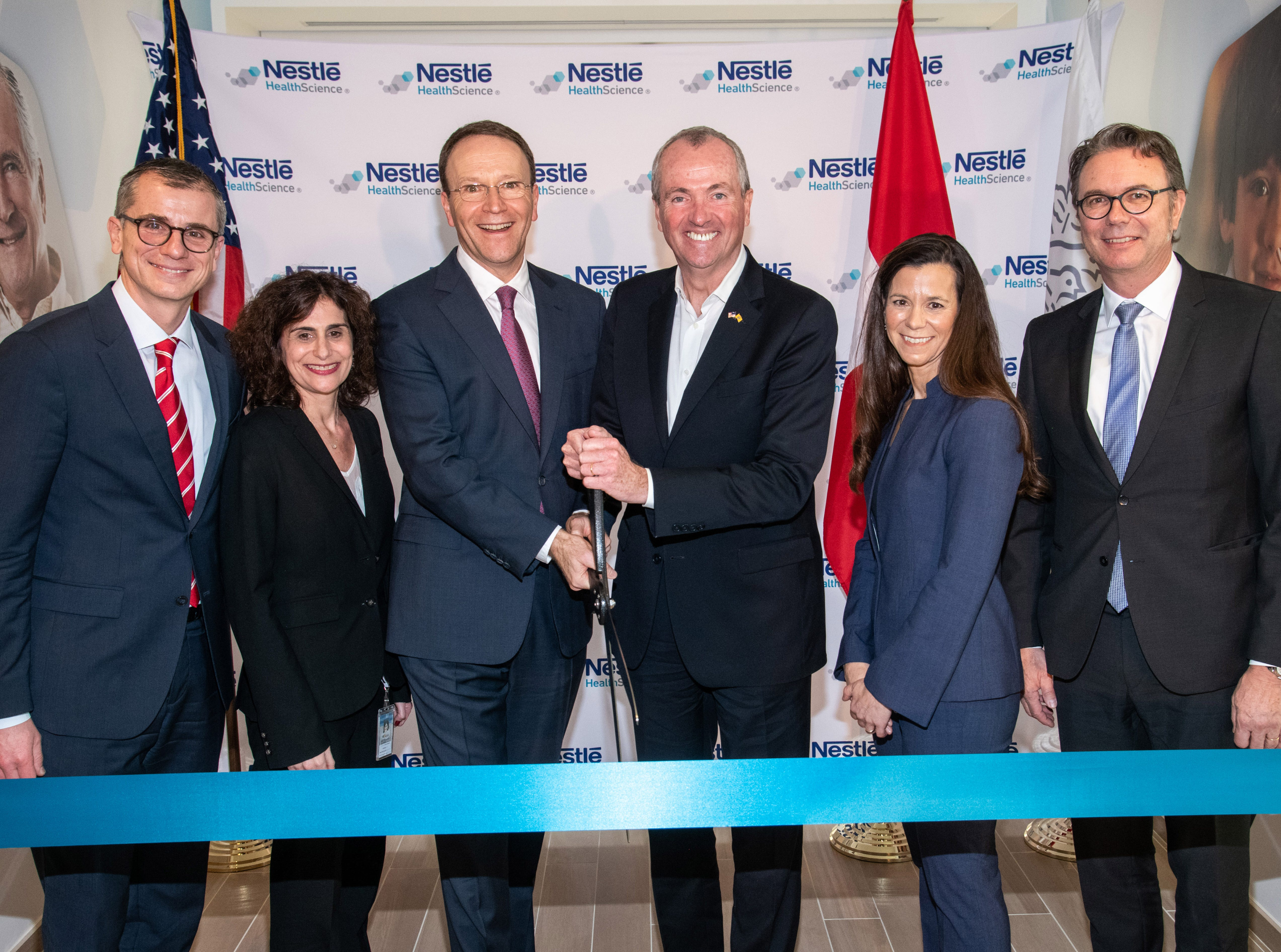 From left to right, Greg Behar, CEO, Nestlé Health Science S.A., Anna Mohl, BEO, Nestlé Health Science U.S., Mark Schneider, CEO, Nestlé S.A., Phil Murphy, Governor of New Jersey, Susan Haid, Head of Nestlé Product Technology Center, Nestlé Health Science and Thomas Hauser, SVP, Head of Global Product & Technology Development, Nestlé S.A. cut the ribbon at the inauguration of Nestlé Health Science's Product Technology Center on Monday, Dec. 3, 2018 in Bridgewater, N.J. (Charles Sykes/AP Images for Nestlé)