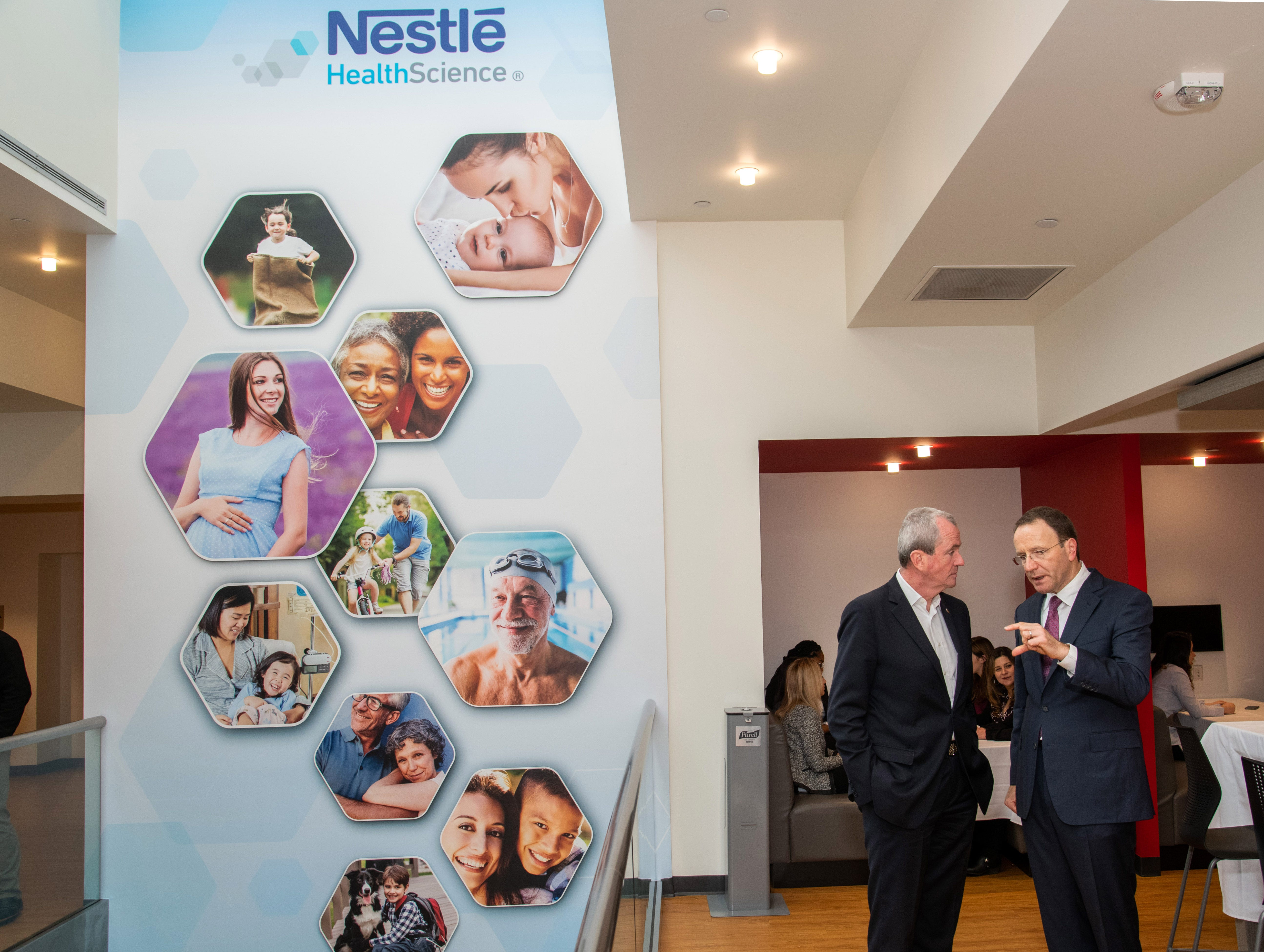Phil Murphy, Governor of New Jersey, left, meets with Mark Schneider, CEO, Nestlé S.A., at the inauguration of Nestlé Health Science's Product Technology Center on Monday, Dec. 3, 2018 in Bridgewater, N.J. (Charles Sykes/AP Images for Nestlé)