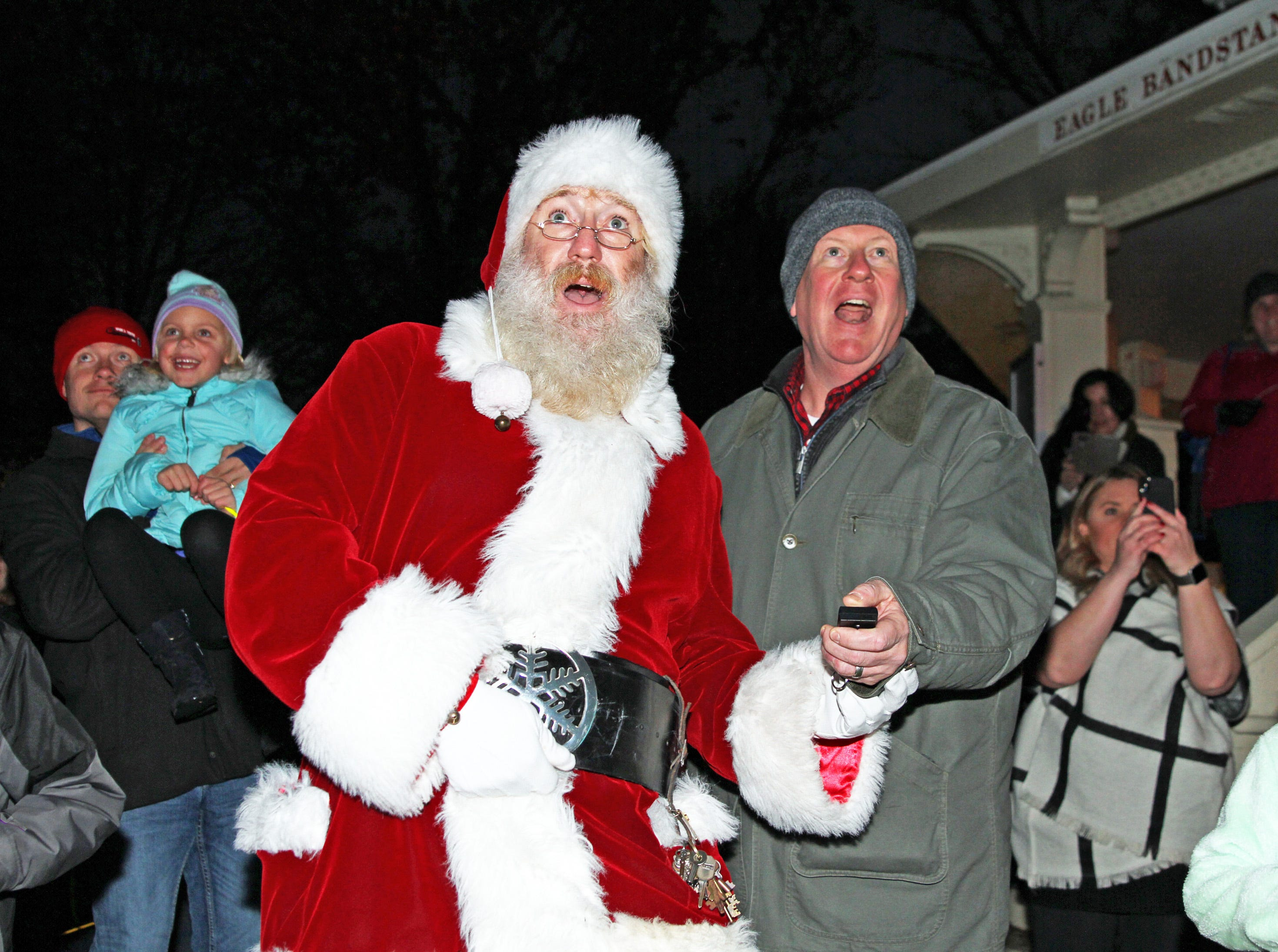 Santa and Urbandale Mayor Bob Andeweg use the remote to light the official tree during UCAN's third annual Light Up Urbandale on Sunday, Dec. 2, 2018 at Lions Park in Urbandale. Holiday festivities included a visit from Santa, crafts, goodies, official tree lighting ceremony, live reindeer and entertainment. This event helps raise awareness and support for the Urbandale Community Action Network Holiday Helping Hands Programs for families, kids, teens and seniors in need.