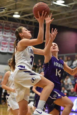 Norwalk's Allison Schumacher goes for a layup as Indianola's Lauren Blake defends. The Indianola girls' basketball team picked up their first win of the season with a 57-34 home victory over Norwalk on Nov. 30, 2018.