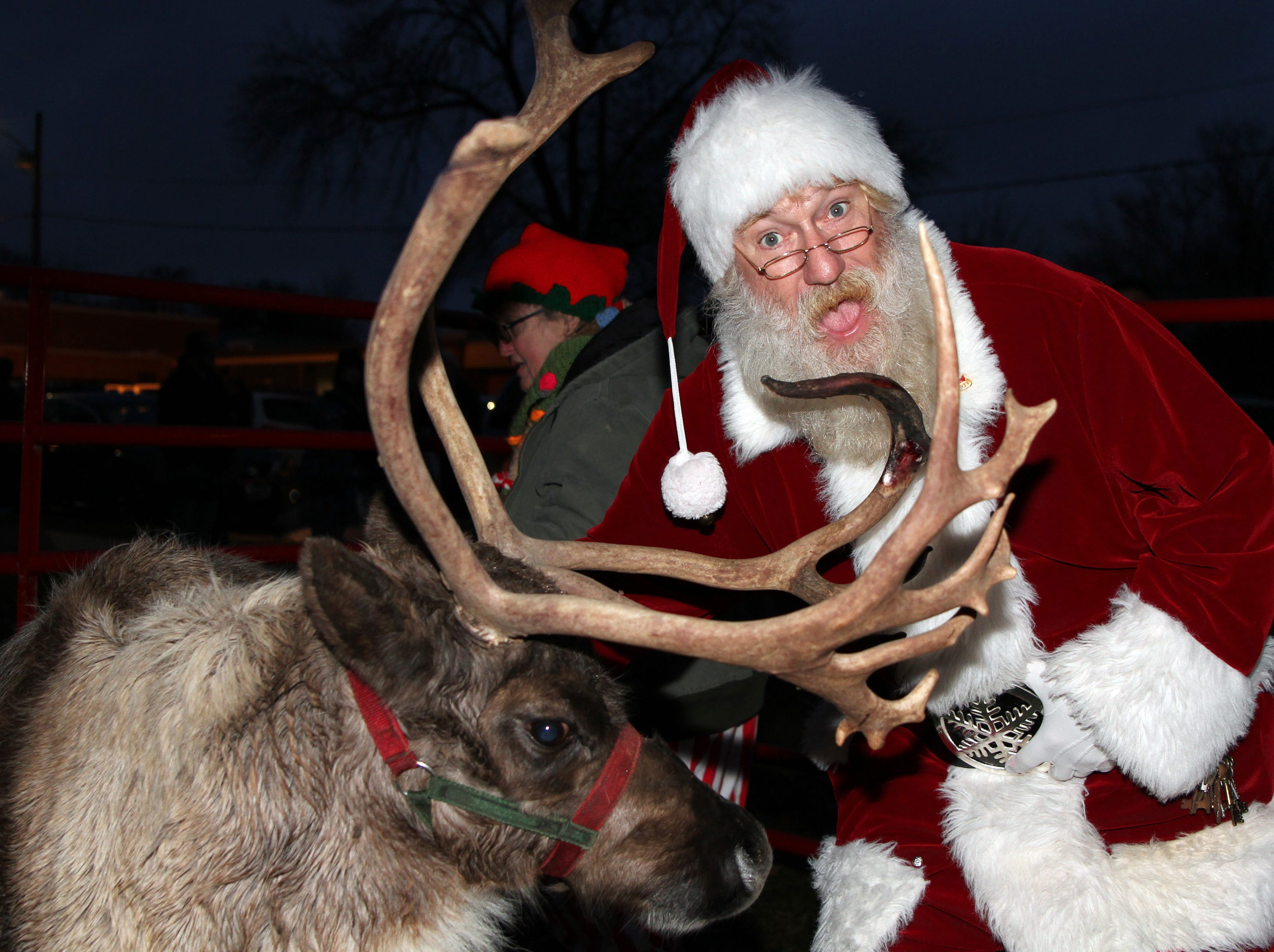 Santa checks on Rudy the Reindeer during UCAN's  third annual Light Up Urbandale on Sunday, Dec. 2, 2018 at Lions Park in Urbandale. Holiday festivities included a visit from Santa, crafts, goodies, official tree lighting ceremony, live reindeer and entertainment.