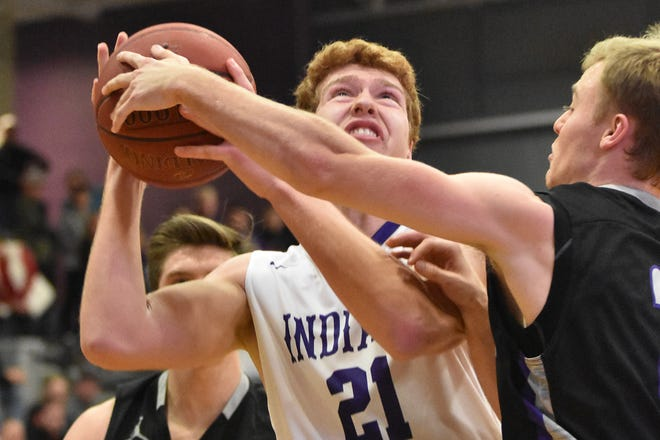 Garrett Aiello, of the Indianola boys basketball team, tries to get a shot. The Indianola boys slipped to 1-1 on the season with a 65-48 home loss to Norwalk on Nov. 30, 2018.