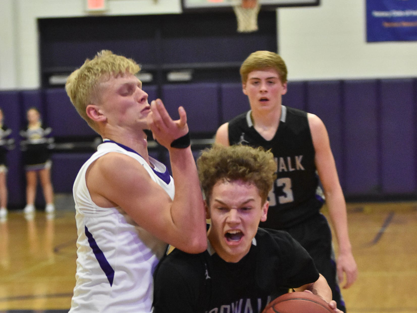 Indianola's Quinn Vesey guards Norwalk's Bowen Born. The Indianola boys slipped to 1-1 on the season with a 65-48 home loss to Norwalk on Nov. 30, 2018.