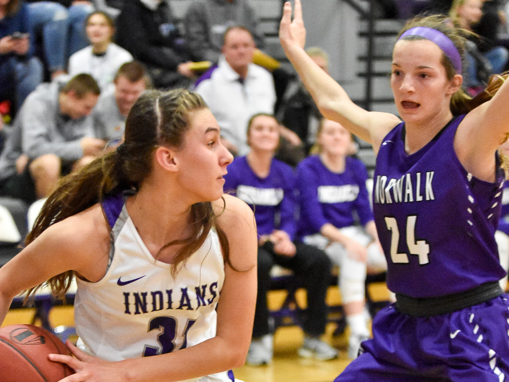 Indianola's Jadyn Forbes looks for an open teammate with Norwalk's Jocelyn Bice guarding. The Indianola girls' basketball team picked up their first win of the season with a 57-34 home victory over Norwalk on Nov. 30, 2018.
