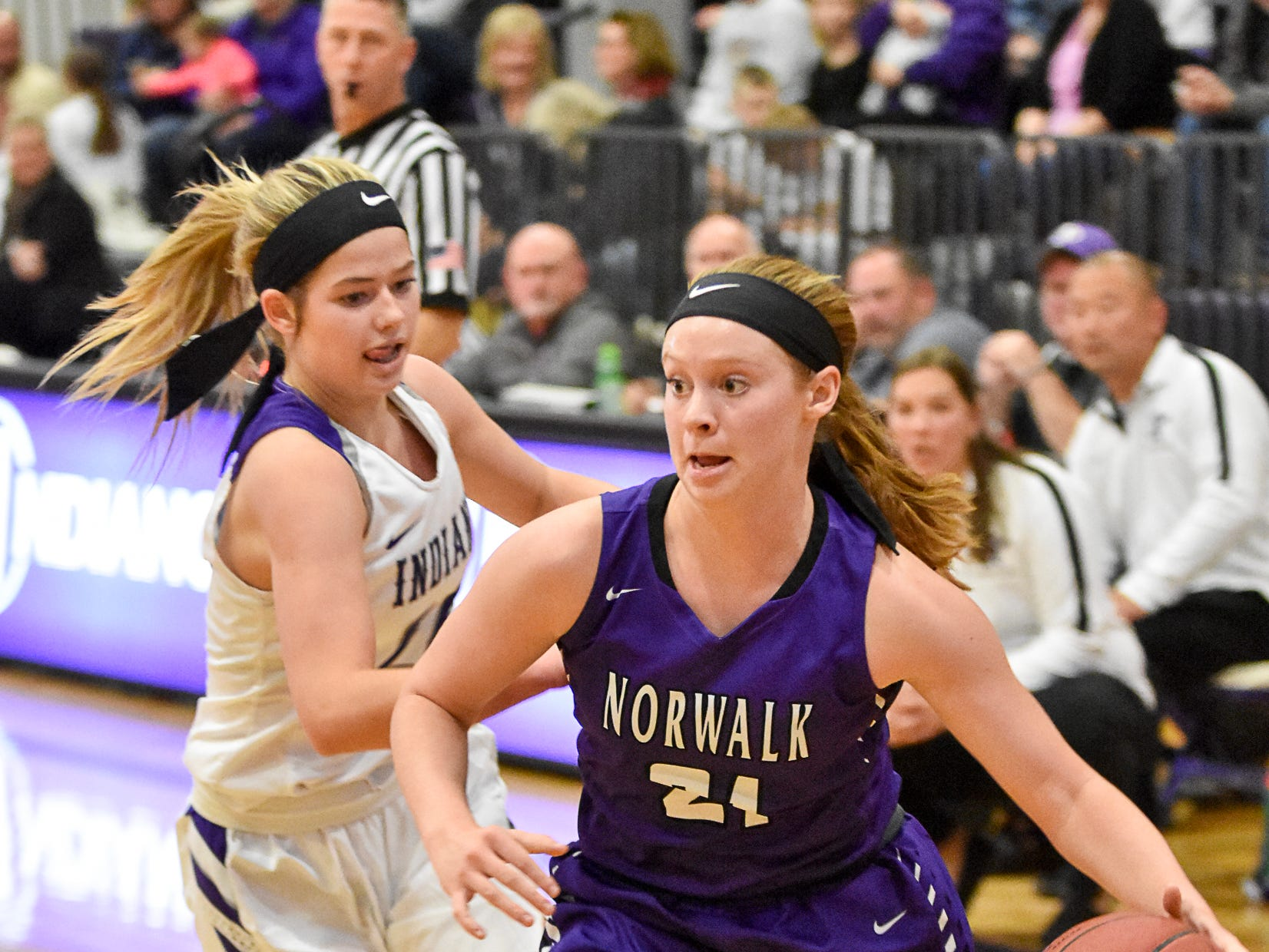 Gianna Bellizzi, of Norwalk High, drives toward the basket. The Indianola girls' basketball team picked up their first win of the season with a 57-34 home victory over Norwalk on Nov. 30, 2018.