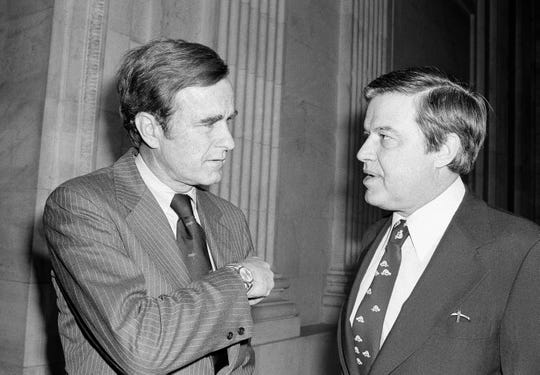 CIA Director George Bush, left, confers with Frank Church, D-Idaho, Chairman of the Senate Intelligence Committee, prior to a closed -door appearance  April 26, 1976 on Capitol Hill. Bush made a last minute appeal to the committee to withhold disclosure of the CIA budget figures.