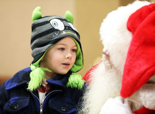 Talon Auch, 4, of Pleasant Hill visits with Santa during Breakfast with Santa on Saturday, Dec. 1, 2018, at the Youth Center in Doanes Park in Pleasant Hill.