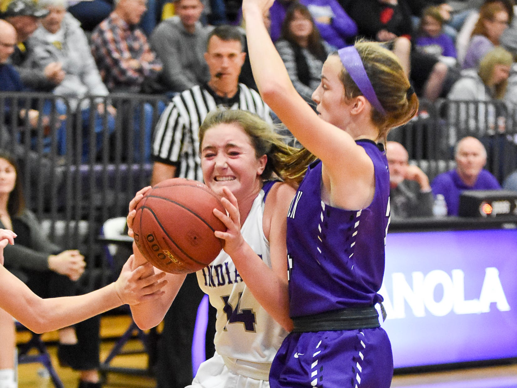 Indianola's Lauren Blake fights to keep the ball. The Indianola girls' basketball team picked up their first win of the season with a 57-34 home victory over Norwalk on Nov. 30, 2018.