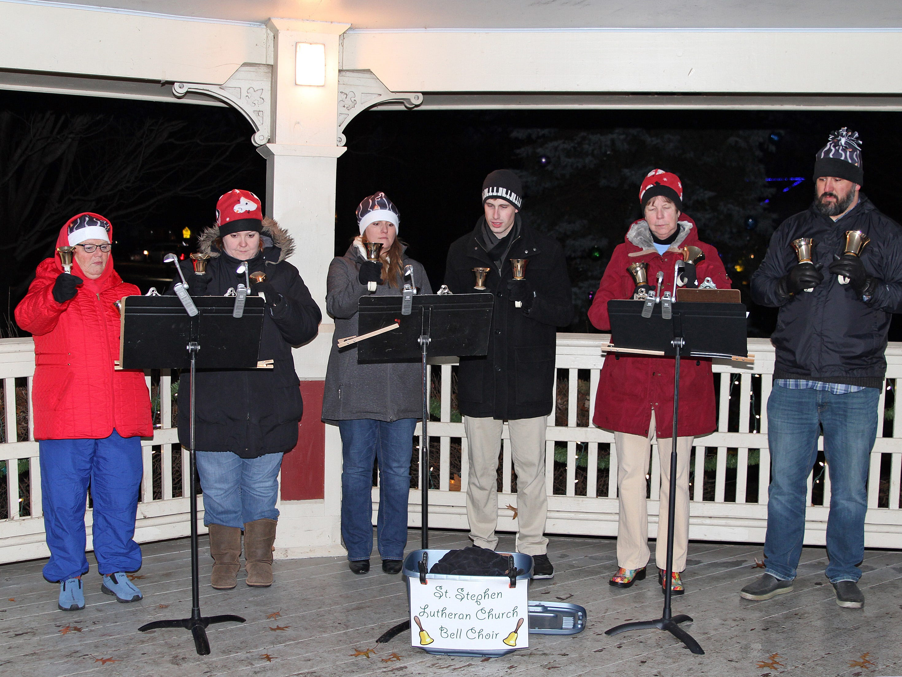 The St. Stephen Lutheran Church Bell Choir plays holiday favorites in the bandstand during UCAN's  third annual Light Up Urbandale on Sunday, Dec. 2, 2018 at Lions Park in Urbandale. Holiday festivities included a visit from Santa, crafts, goodies, official tree lighting ceremony, live reindeer and entertainment.