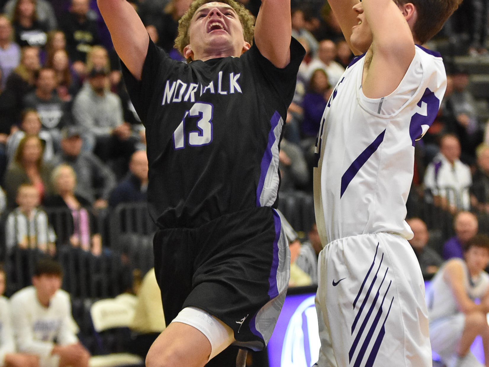 Bowen Born goes in for a layup with Indianola's Tyce Johnson defending. The Indianola boys slipped to 1-1 on the season with a 65-48 home loss to Norwalk on Nov. 30, 2018.