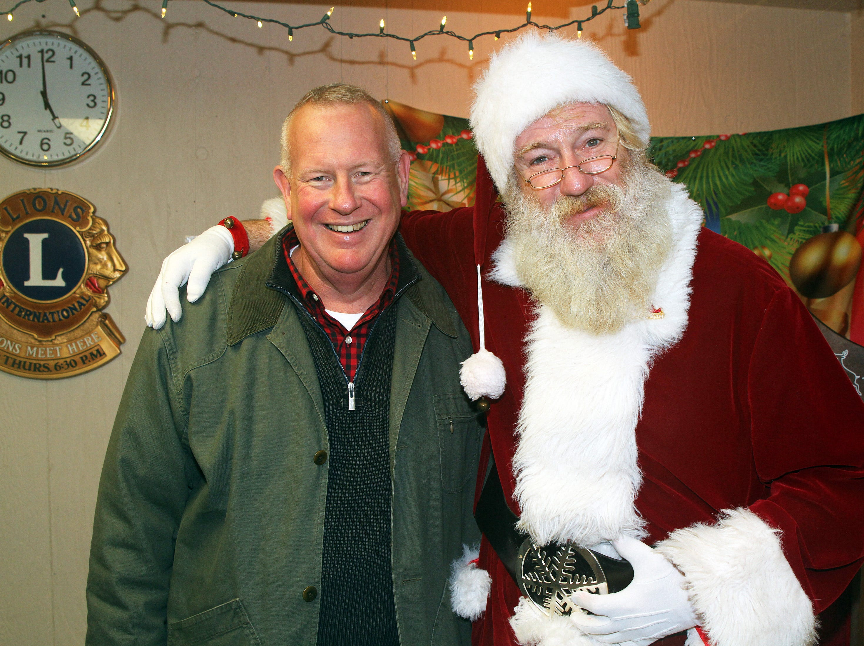 Mayor Bob Andeweg and Santa pose for a picture during UCAN's third annual Light Up Urbandale on Sunday, Dec. 2, 2018 at Lions Park in Urbandale. Holiday festivities included a visit from Santa, crafts, goodies, official tree lighting ceremony, live reindeer and entertainment.