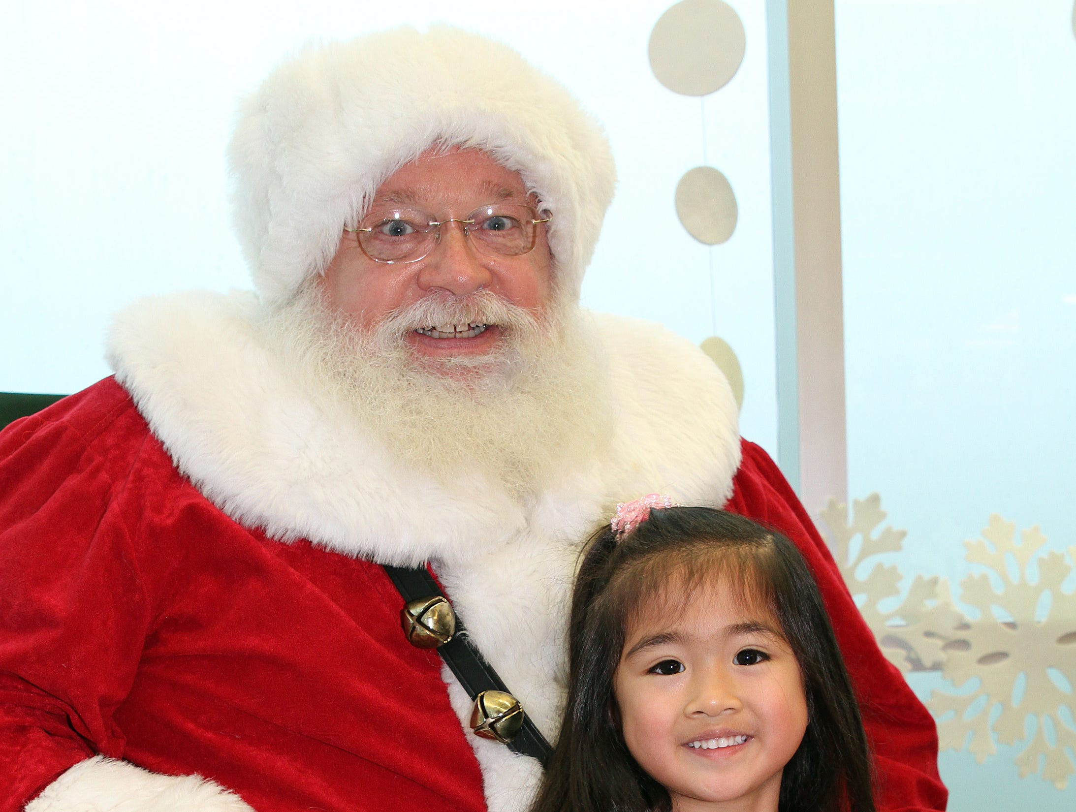 Shea Mary Minaldo, 4, of Johnston sits with Santa during Holidays in Johnston on Saturday, Dec. 1, 2018 at the Johnston Public Library featuring a gingerbread house contest, cookie decorating, holiday music performed by the Johnston Middle School Ninth Grade Chamber Choir, story time and Santa.