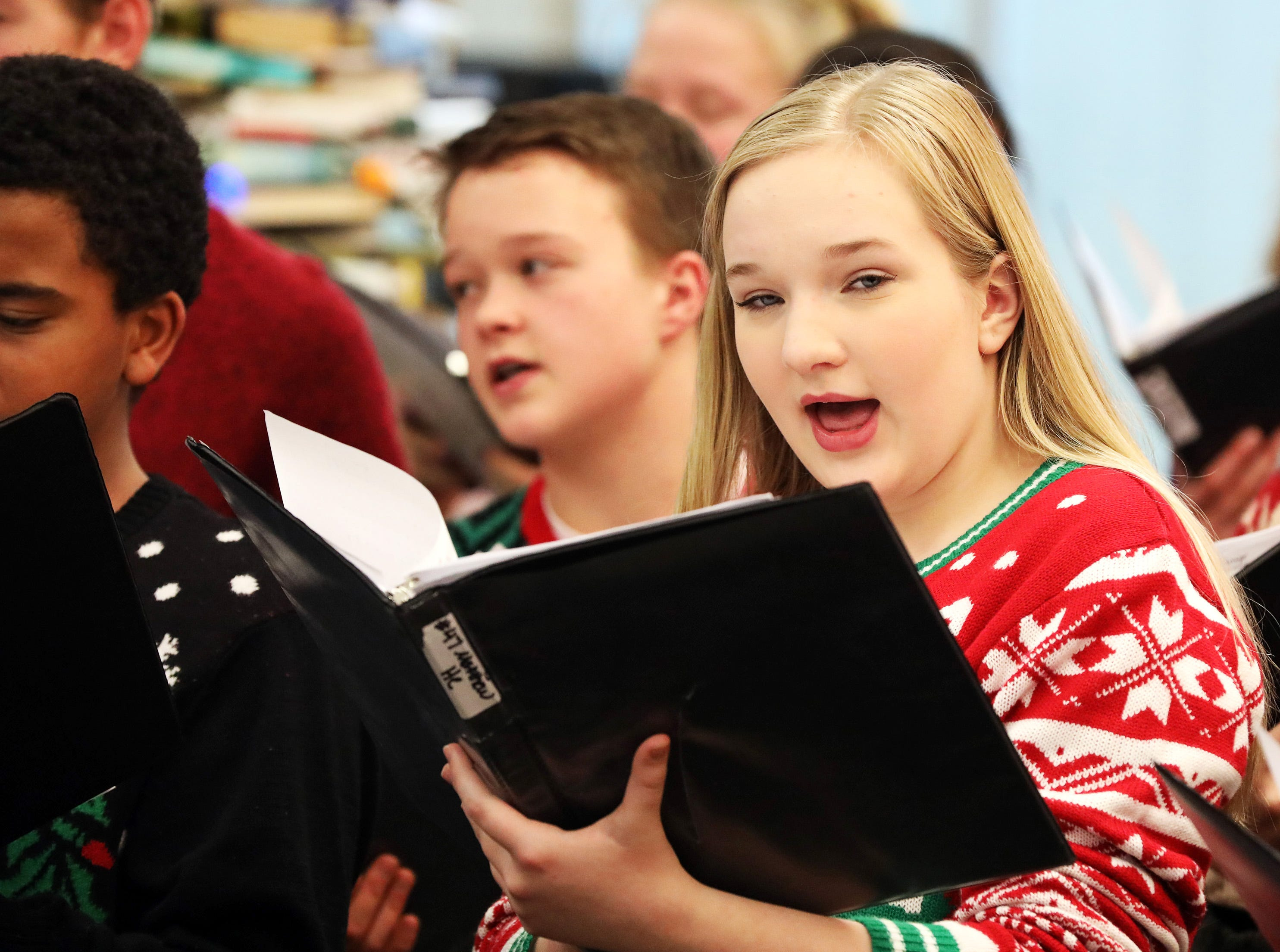 Paige Winkelman sings holiday music with the Johnston Middle School Ninth Grade Chamber Choir during Holidays in Johnston on Saturday, Dec. 1, 2018 at the Johnston Public Library.