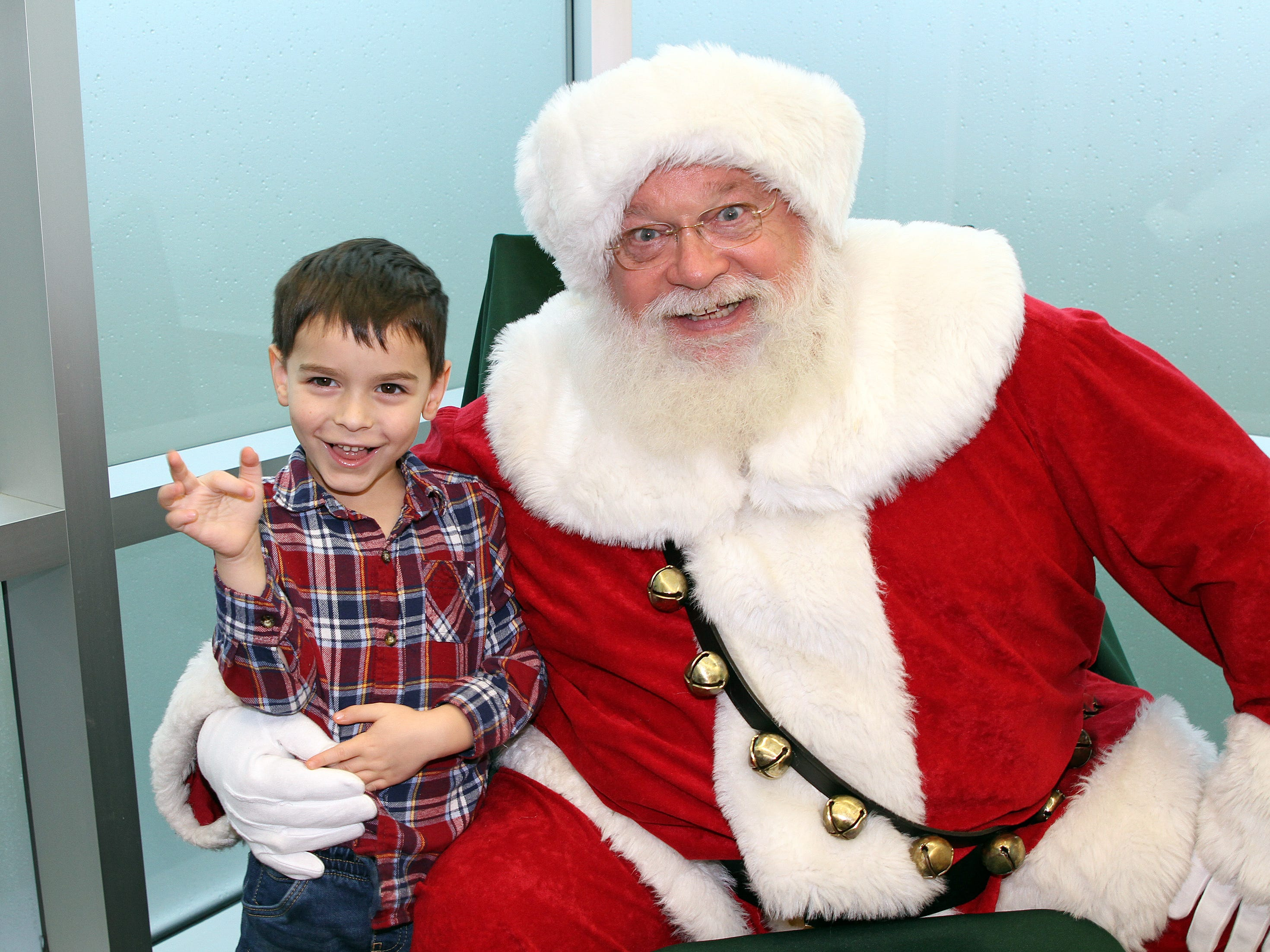 Lance Oliver, 5, of Johnston stops for a photo with Santa during Holidays in Johnston on Saturday, Dec. 1, 2018 at the Johnston Public Library featuring a gingerbread house contest, cookie decorating, holiday music performed by the Johnston Middle School Ninth Grade Chamber Choir, story time and Santa.