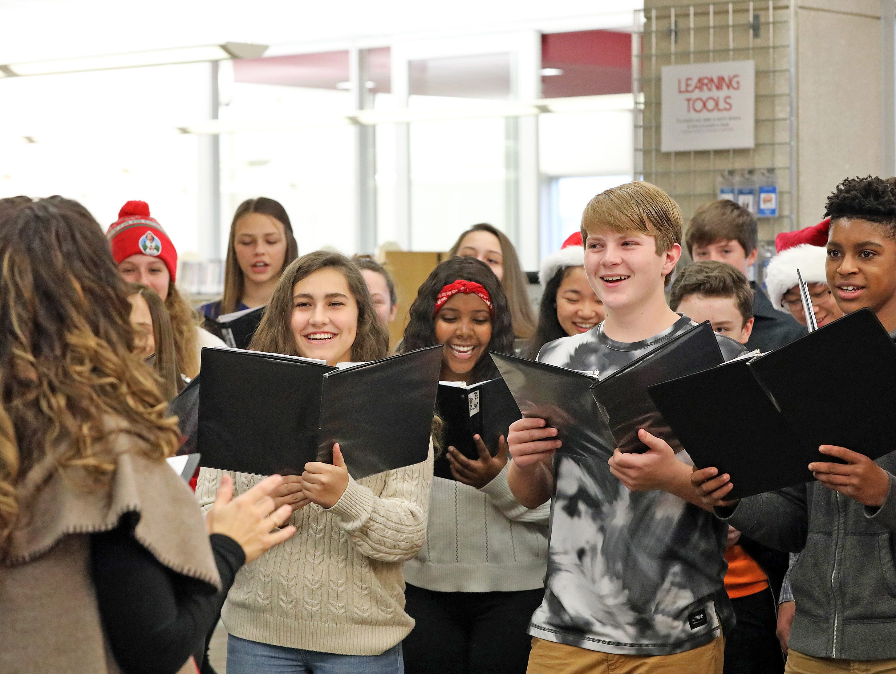 Vocal Music Teacher Laura Grimm directs the Johnston Middle School Ninth Grade Chamber Choir during Holidays in Johnston on Saturday, Dec. 1, 2018 at the Johnston Public Library.