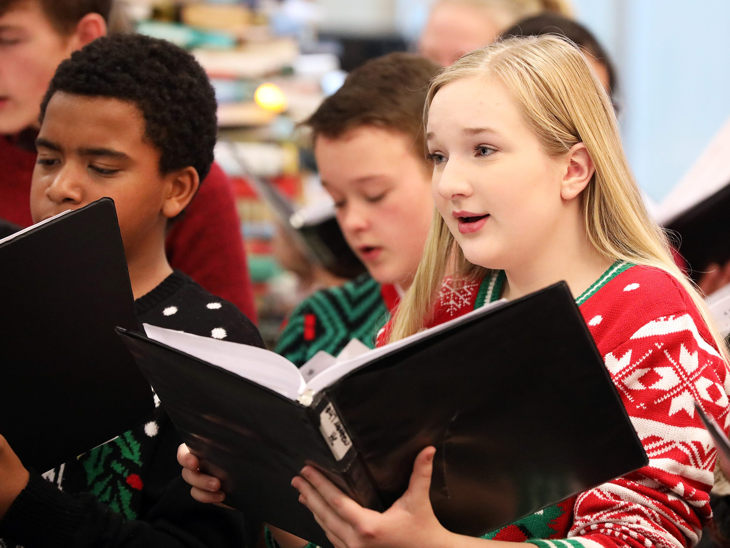 Paige Winkelman sings holiday music with the Johnston Middle School Ninth Grade Chamber Choir during Holidays in Johnston on Saturday, Dec. 1, 2018 at the Johnston Public Library featuring gingerbread house contest, cookie decorating, story and craft time and Santa.