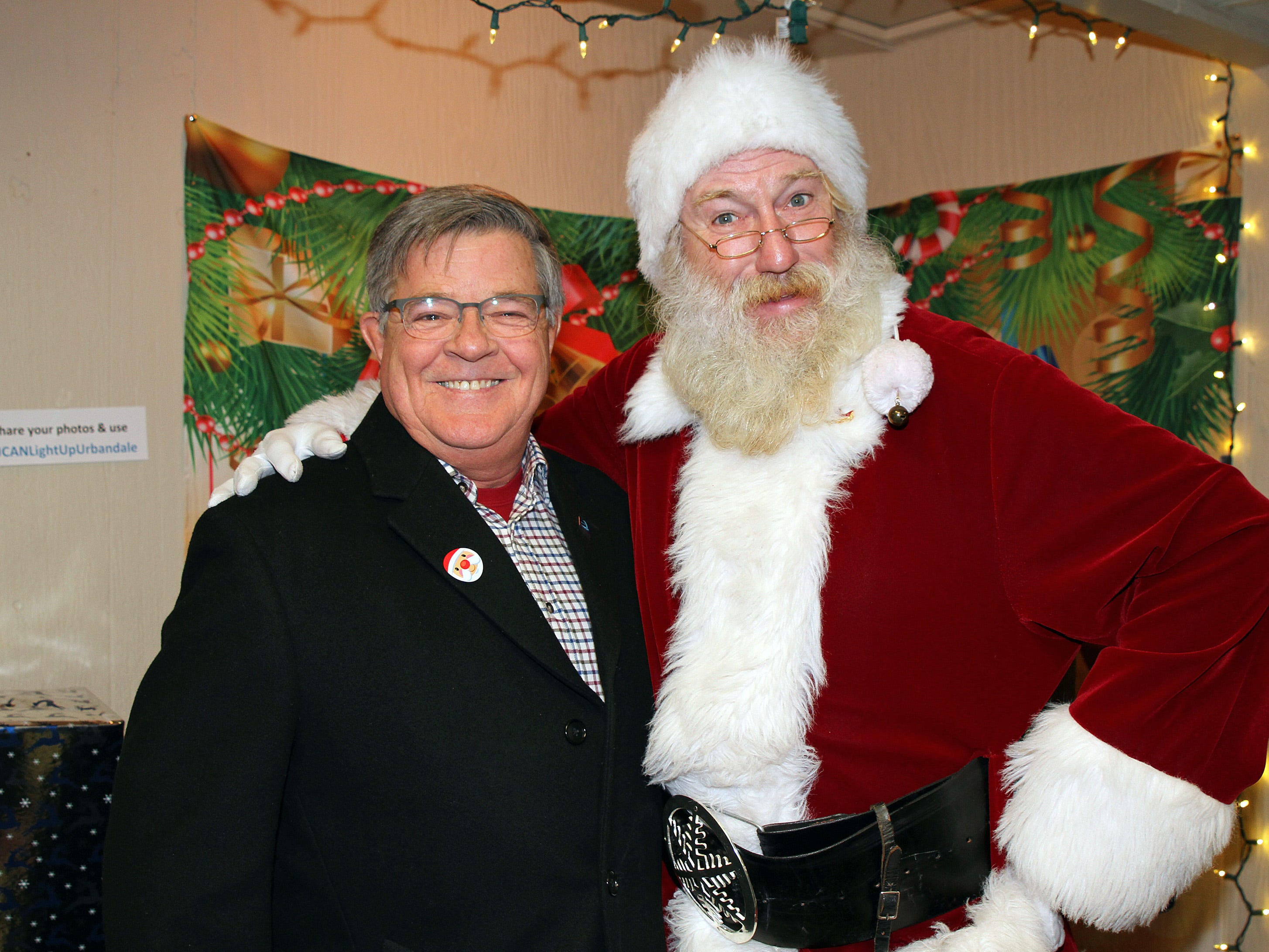 Urbandale City Council Member David Russell joins Santa during UCAN's third annual Light Up Urbandale on Sunday, Dec. 2, 2018 at Lions Park in Urbandale. Holiday festivities included a visit from Santa, crafts, goodies, official tree lighting ceremony, live reindeer and entertainment.