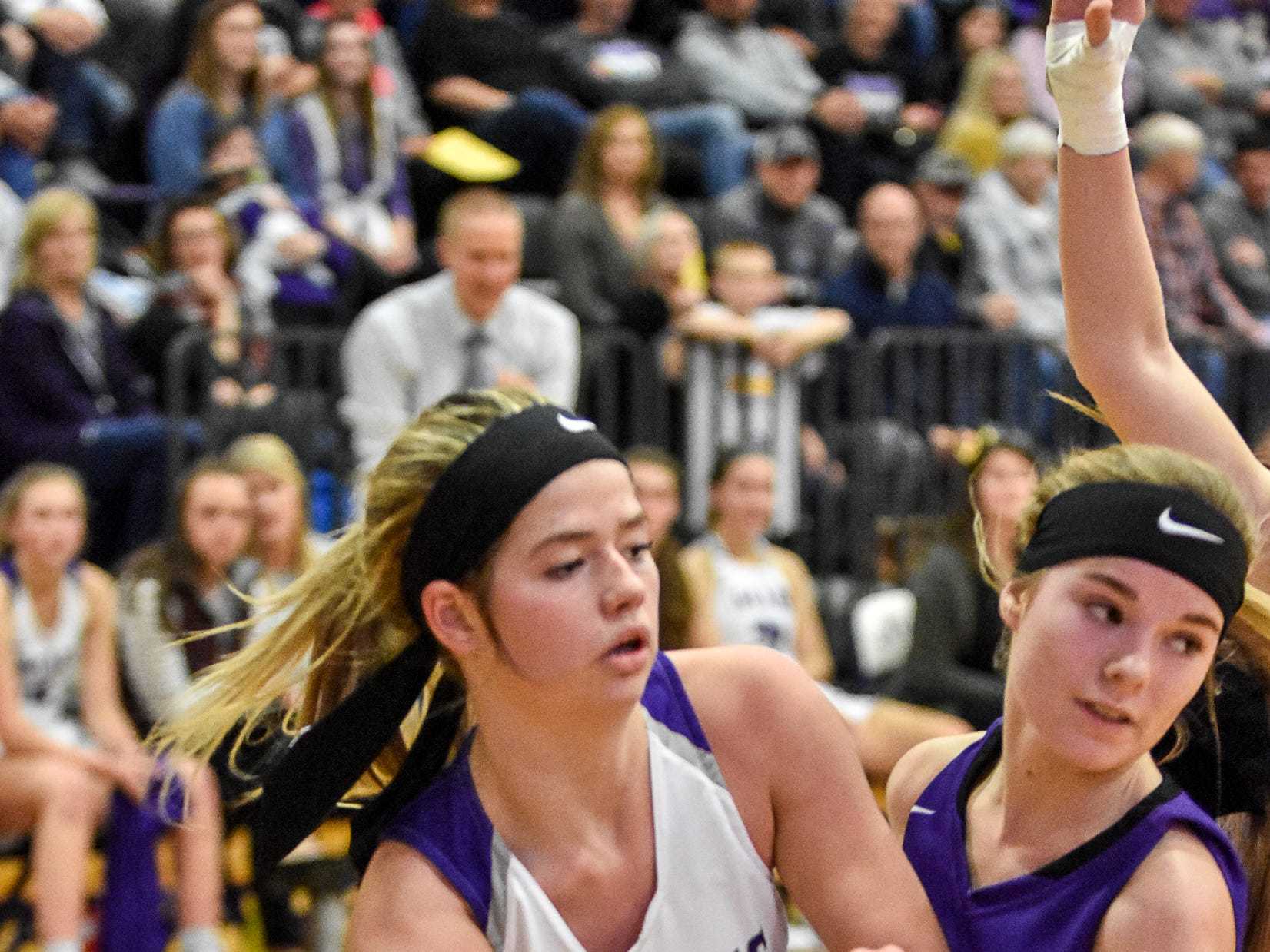 Indianola's Mara Bishop and Norwalk's  Jayden Lammers watch Bishop's pass. The Indianola girls' basketball team picked up their first win of the season with a 57-34 home victory over Norwalk on Nov. 30, 2018.