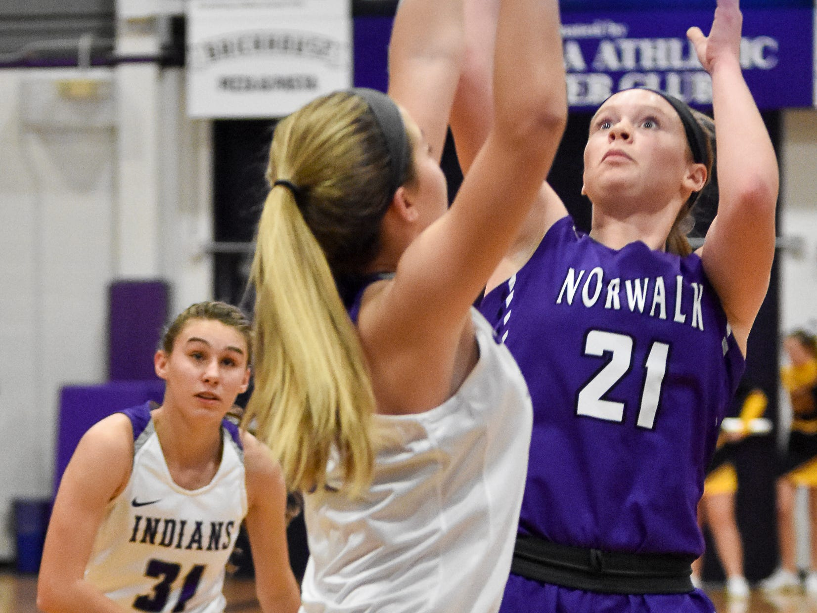 Indianola's Kendall Clatt guards Gianna Bellizzi. The Indianola girls' basketball team picked up their first win of the season with a 57-34 home victory over Norwalk on Nov. 30, 2018.