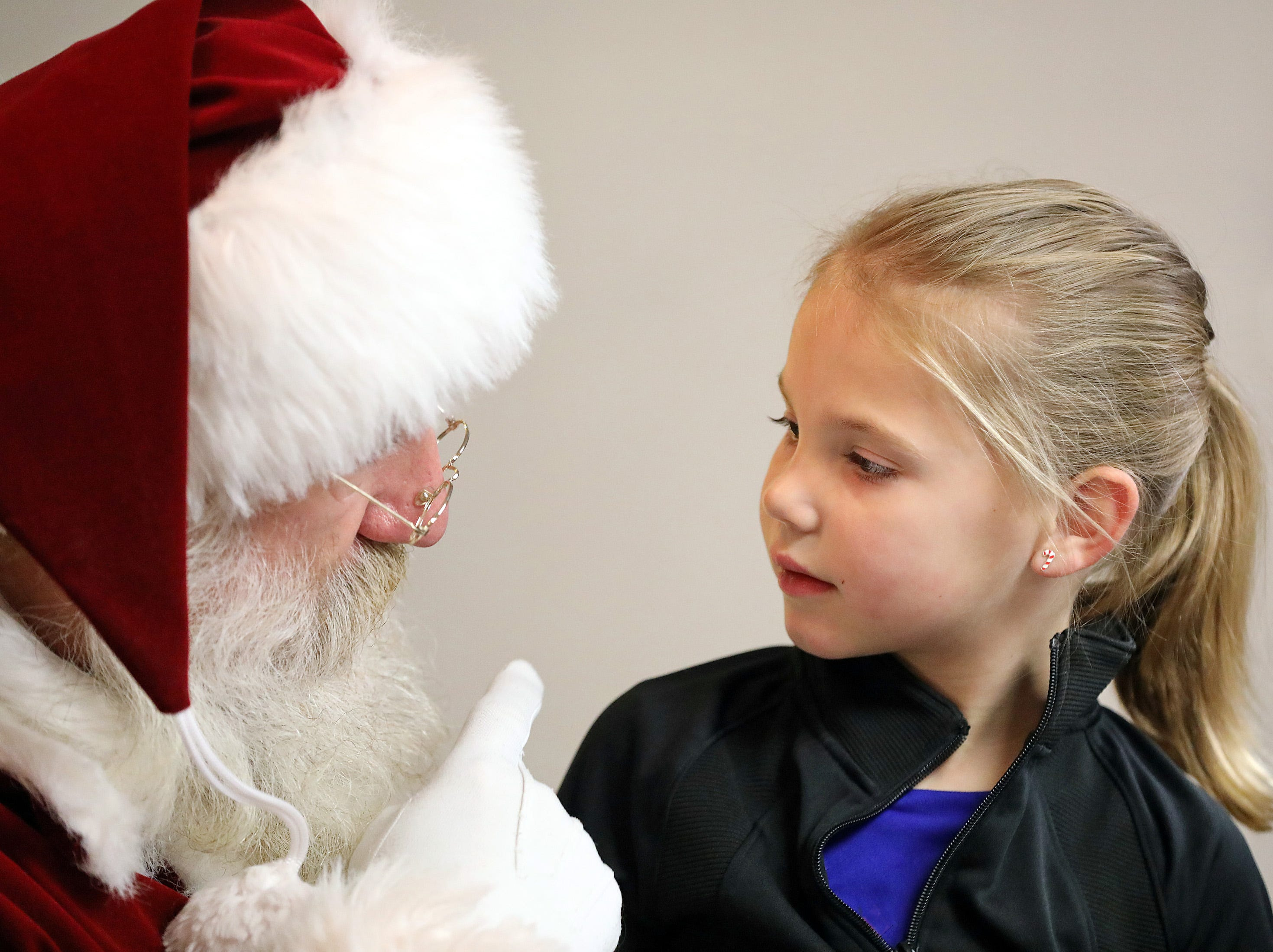Mollie Darling, 5, of Urbandale visits with Santa during UCAN's  third annual Light Up Urbandale on Sunday, Dec. 2, 2018 at Lions Park in Urbandale. Holiday festivities included a visit from Santa, crafts, goodies, official tree lighting ceremony, live reindeer and entertainment.