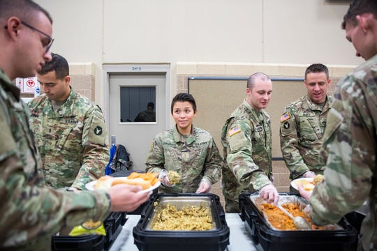 2nd Lt. Trang Jorgensen, the Iowa National Guard's first and only female officer in the infantry, helps serve food during a family day pot-luck on Sunday, Dec. 2, 2018, at Camp Dodge. Jorgensen knew since childhood that she wanted to serve in the military.