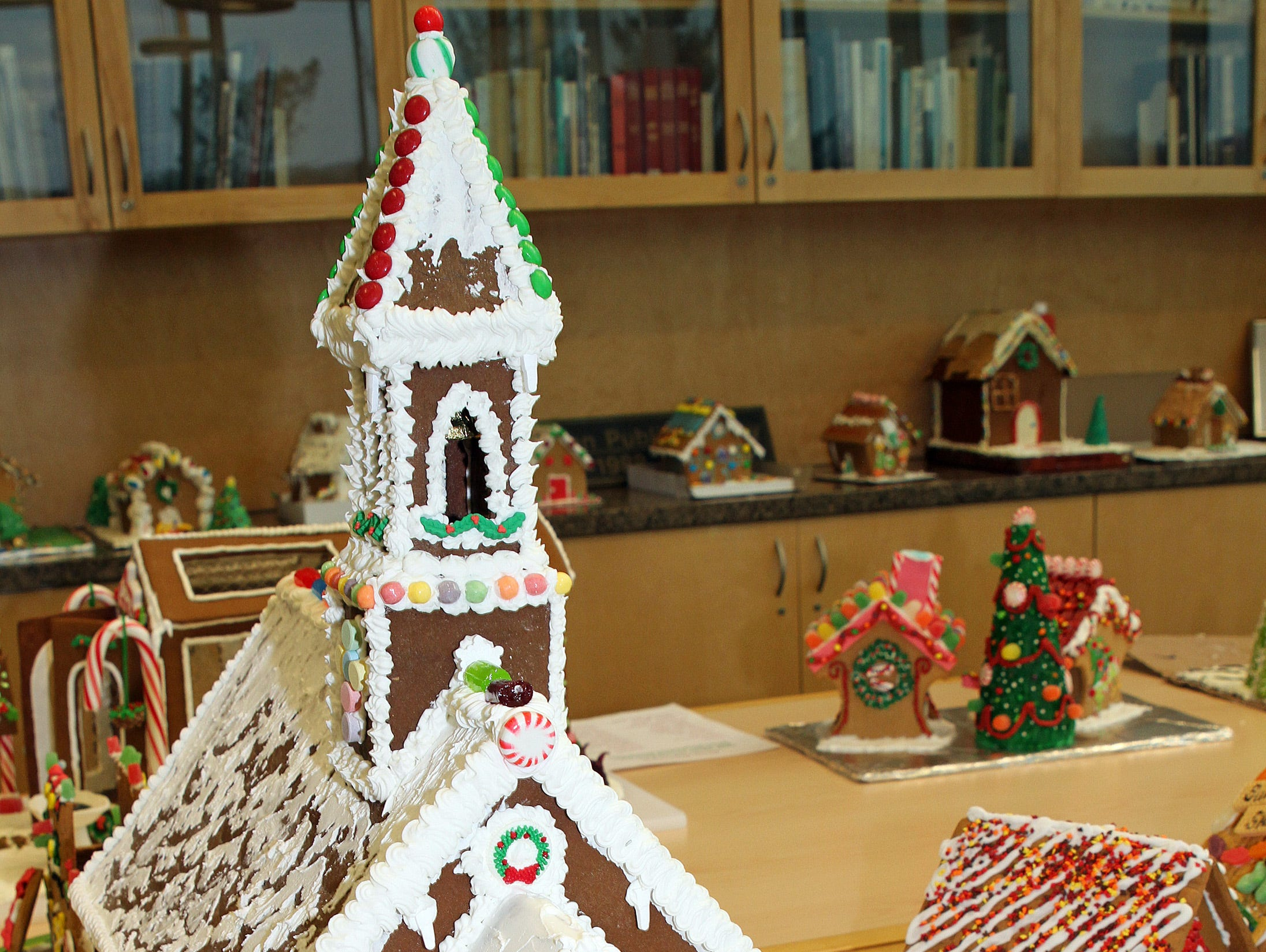 Gingerbread houses are on display during Holidays in Johnston on Saturday, Dec. 1, 2018 at the Johnston Public Library featuring a gingerbread house contest, cookie decorating, holiday music performed by the Johnston Middle School Ninth Grade Chamber Choir, story time and Santa.