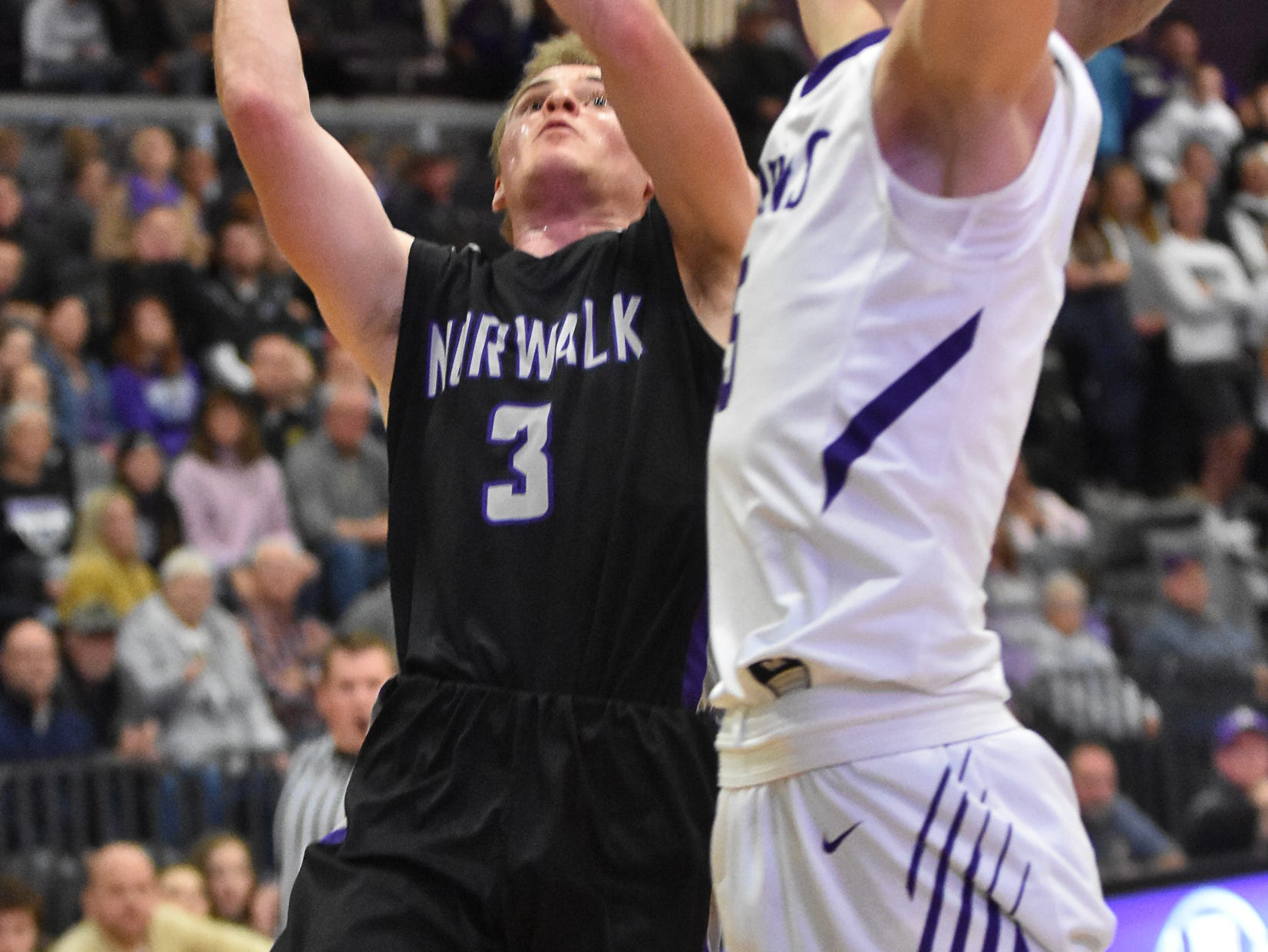 Norwalk's Scott Anderson shoots as an Indianola team member tries to block him. The Indianola boys slipped to 1-1 on the season with a 65-48 home loss to Norwalk on Nov. 30, 2018.