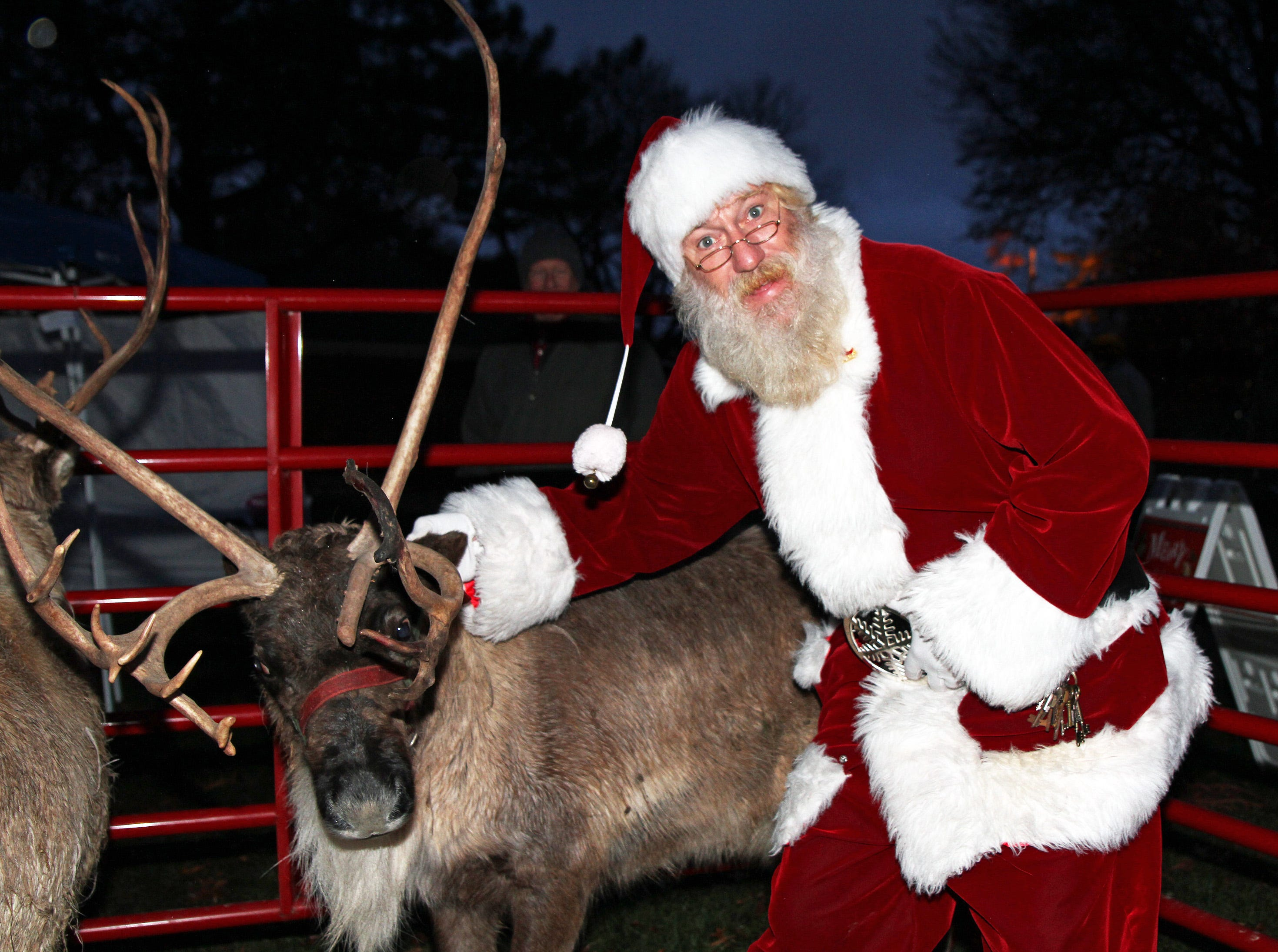 Santa checks on Rudy the Reindeer during UCAN's third annual Light Up Urbandale on Sunday, Dec. 2, 2018 at Lions Park in Urbandale. Holiday festivities included a visit from Santa, crafts, goodies, official tree lighting ceremony, live reindeer and entertainment. This event helps raise awareness and support for the Urbandale Community Action Network Holiday Helping Hands Programs for families, kids, teens and seniors in need.