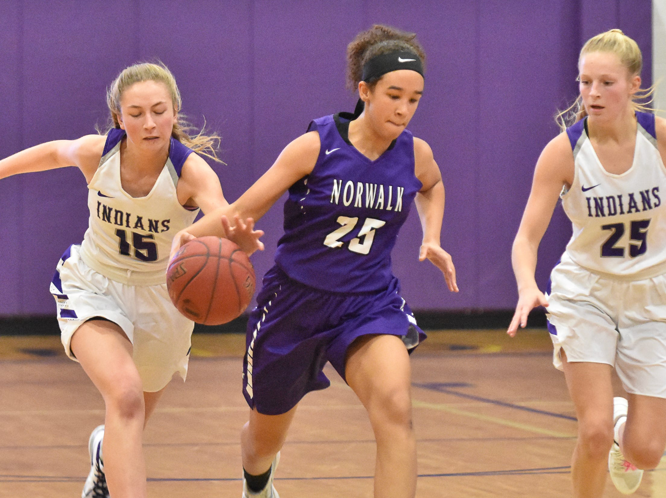 Norwalk's Olivia Johnson heads down the court with Indianola's Alley May and Allison Coffey in pursuit. The Indianola girls' basketball team picked up their first win of the season with a 57-34 home victory over Norwalk on Nov. 30, 2018.