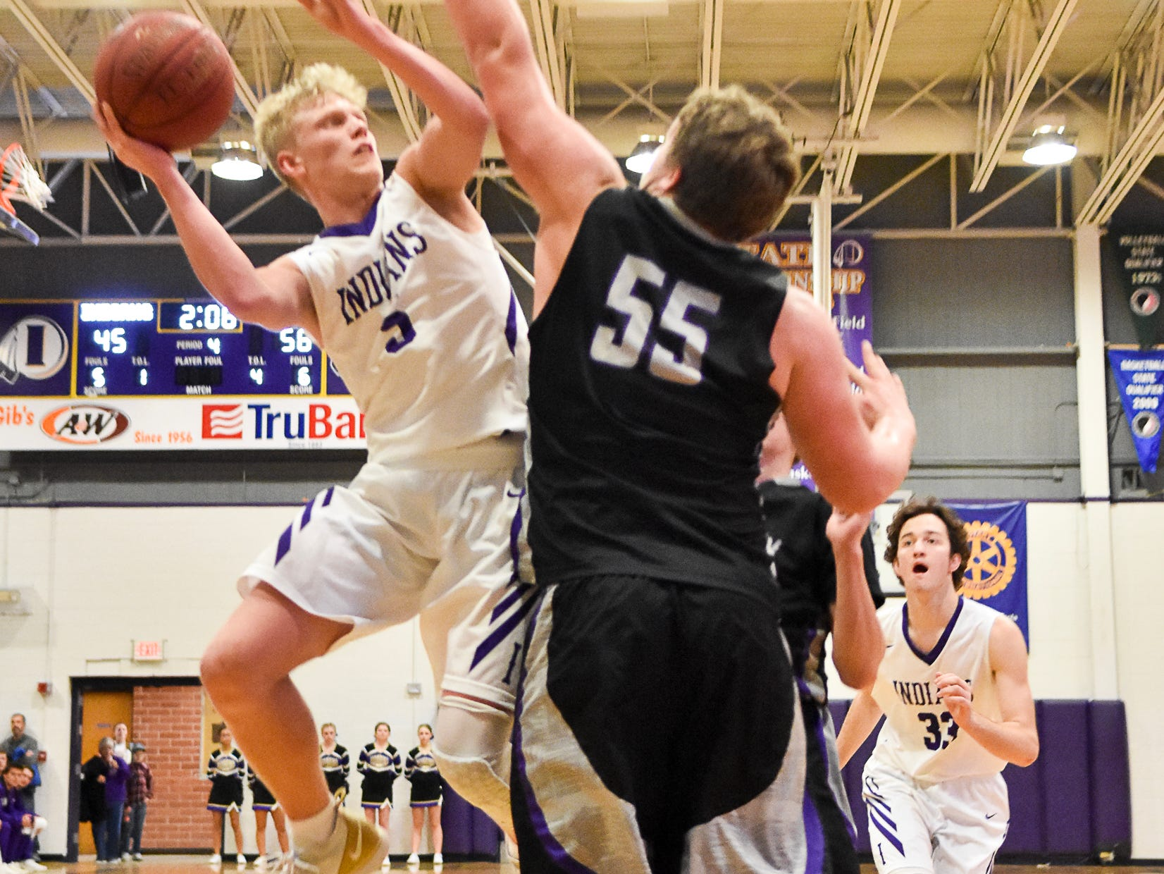 Norwalk's Tyler Endres defends against Quinn Vesey, of Indianola's boys basketball team. The Indianola boys slipped to 1-1 on the season with a 65-48 home loss to Norwalk on Nov. 30, 2018.