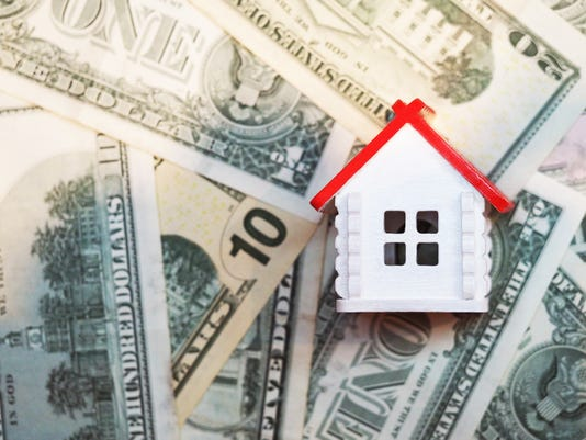 Invest In Real Estate Mortgage Concept White House With A Red Roof On The Background Of Dollar Bills