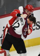 Detroit Red Wings' Anthony Mantha fights with Colorado Avalanche defenseman Patrik Nemeth during the third period in Detroit, Sunday, Dec. 2, 2018.