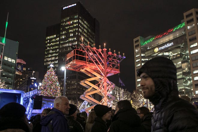 People watch as during the annual lighting of the Hanukkah menorah by Chabad, at Campus Martius in Detroit on Sunday, Nov. 2, 2018 in Detroit.
