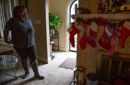 "Cynthia Wright, 48, of Detroit talks about her neighbors Monday, Dec. 3, 2018 from her living room. An alleged self-defense shooting took place just a few houses from hers. ""I don't have a gun, I don't want a gun but I might have to have one."" said Wright."