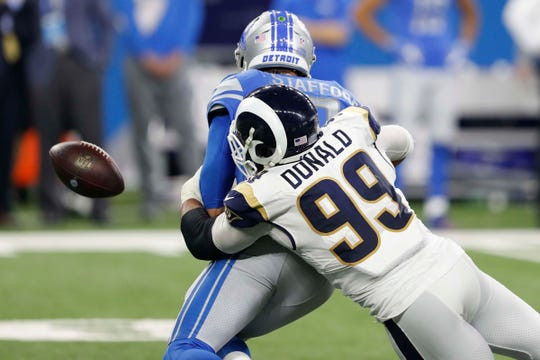 Los Angeles Rams defensive tackle Aaron Donald causes a fumble against Detroit Lions quarterback Matthew Stafford during the fourth quarter at Ford Field, Dec. 2, 2018.