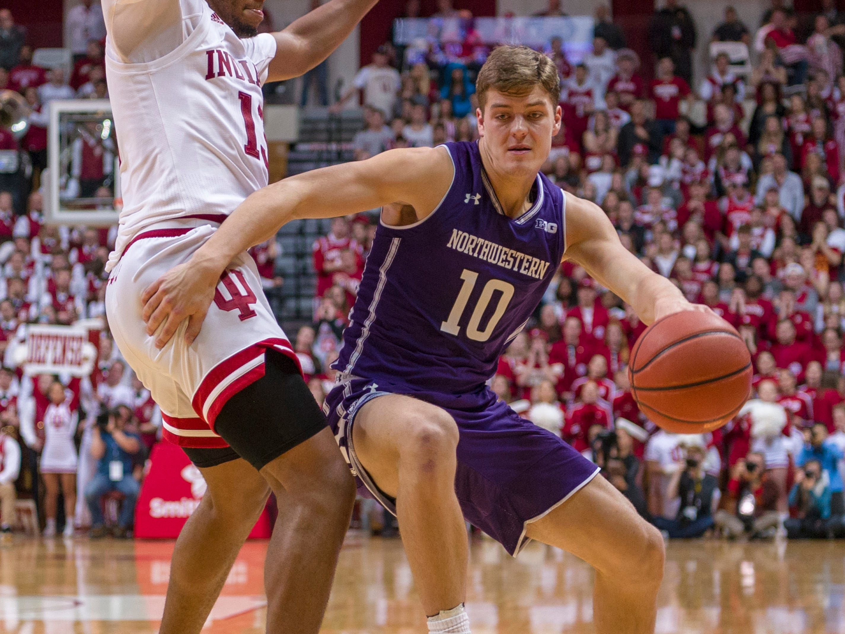 Northwestern forward Miller Kopp (10) makes a move around the defense of Indiana forward Juwan Morgan (13) during the first half of an NCAA college basketball game Saturday, Dec. 1, 2018, in Bloomington, Ind. (AP Photo/Doug McSchooler)