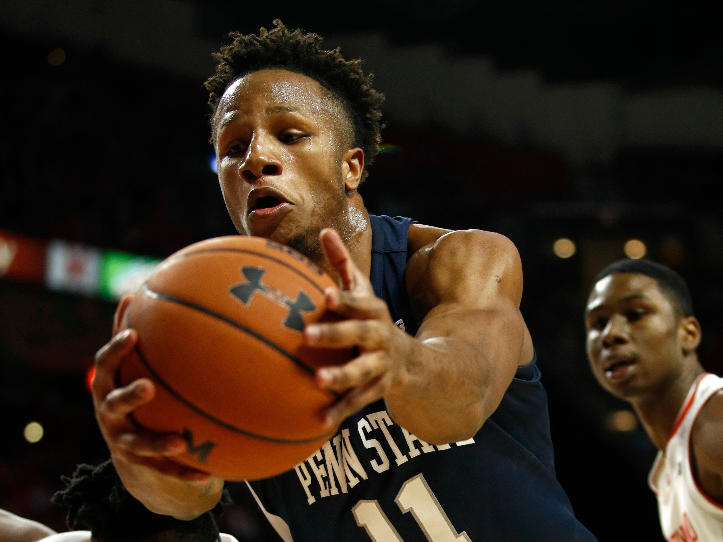 Penn State forward Lamar Stevens (11) grabs a rebound in front of Maryland forward Jalen Smith, back left, and guard Serrel Smith Jr. in the first half of an NCAA college basketball game, Saturday, Dec. 1, 2018, in College Park, Md. (AP Photo/Patrick Semansky)