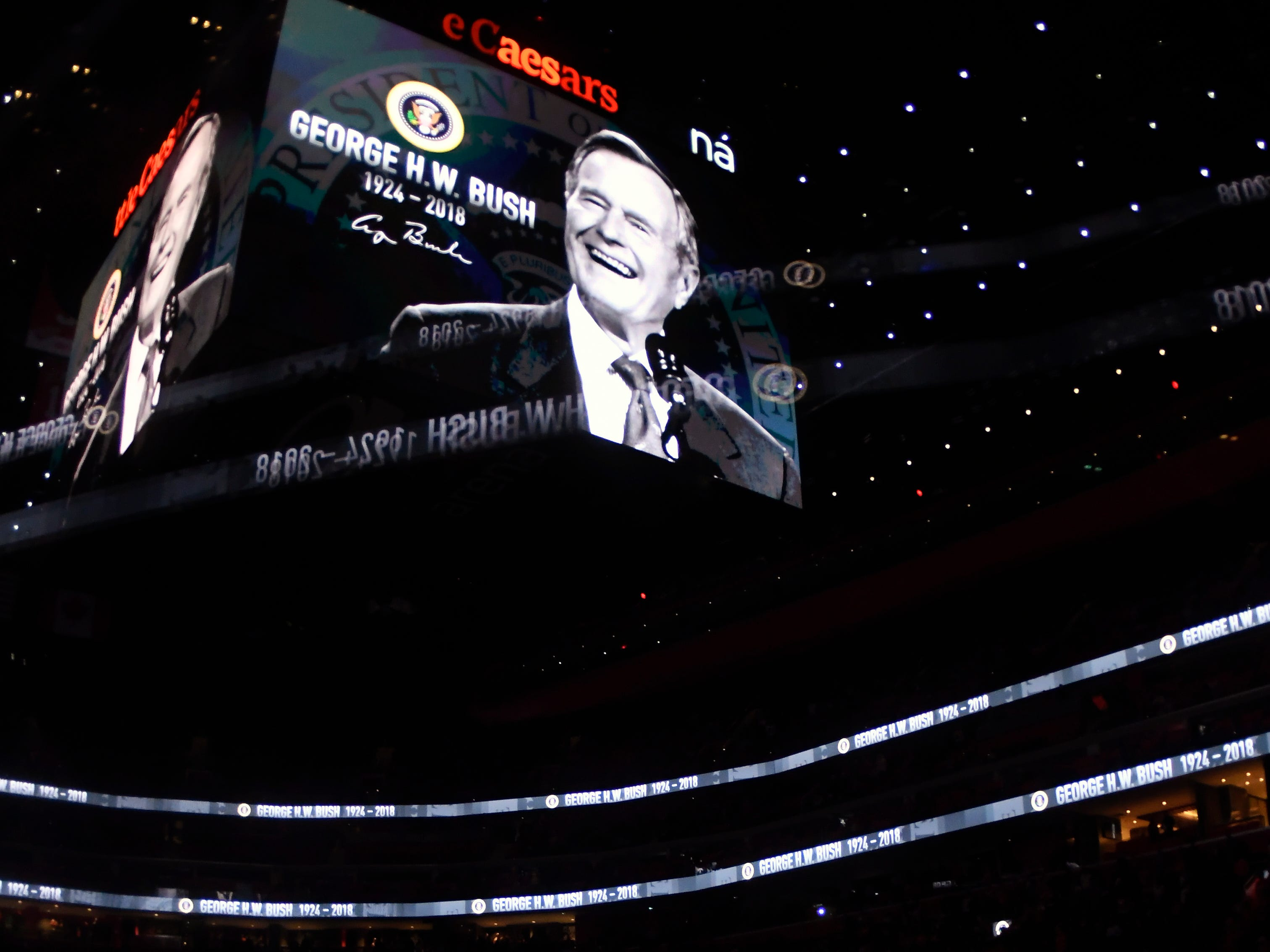 A moment of silence is held for former United States President George H.W. Bush before an NHL hockey game between the Colorado Avalanche and the Detroit Red Wings, Sunday, Dec. 2, 2018, in Detroit. Bush died Friday, Nov. 30, 2018.