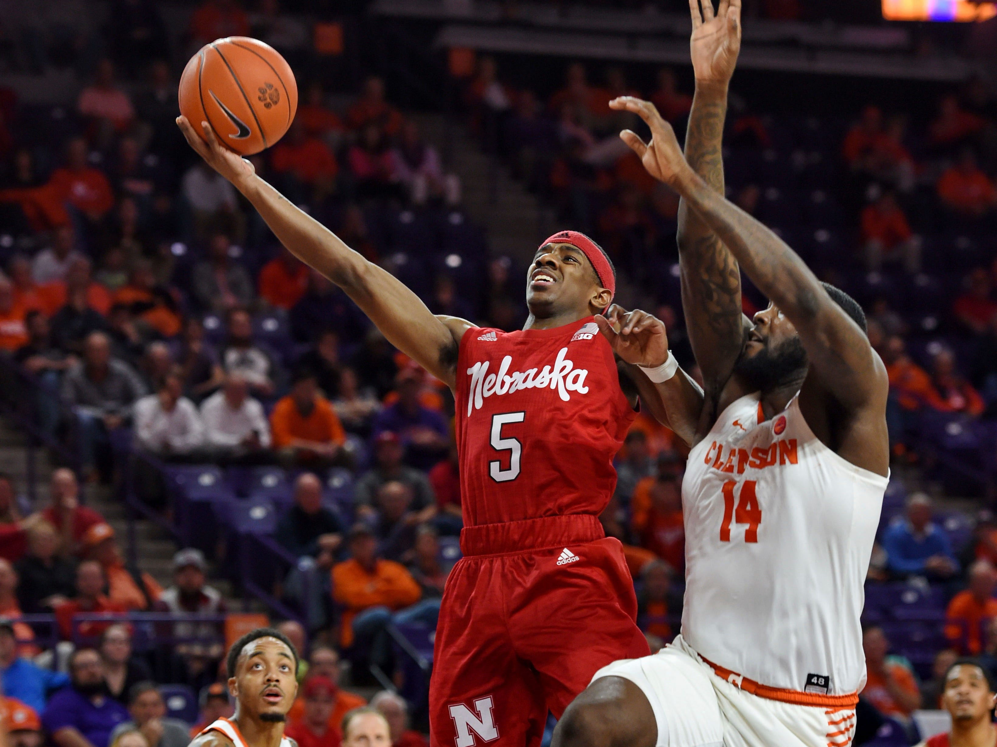 Nebraska's Glynn Watson Jr. drives in for a score while defended by Clemson's Elijah Thomas during the second half of an NCAA college basketball game Monday, Nov. 26, 2018, in Clemson, S.C. (AP Photo/Richard Shiro)