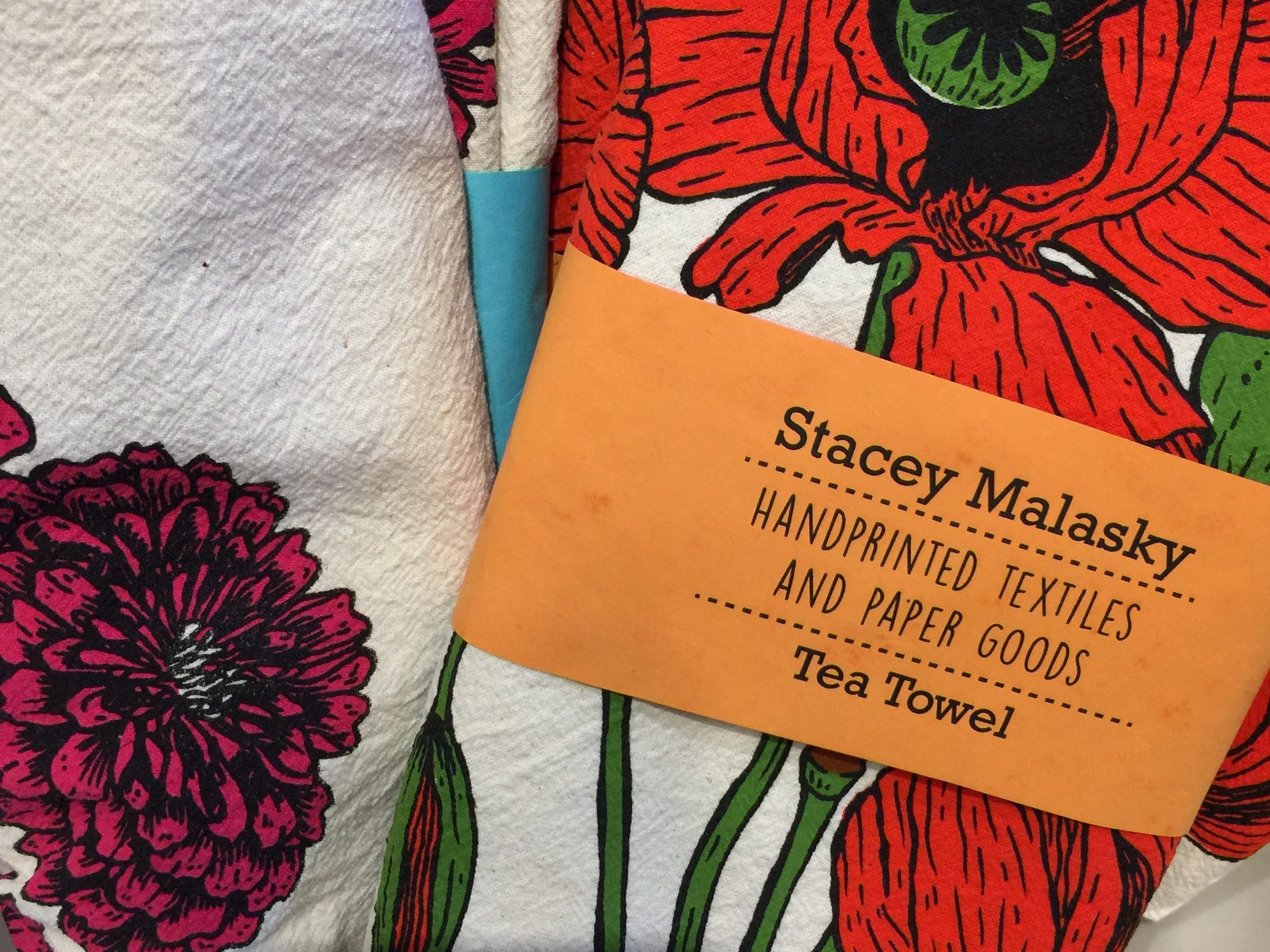 Bright, bold flowers bring these handprinted Stacy Malasky tea towels to life. They're available at Post in Detroit.