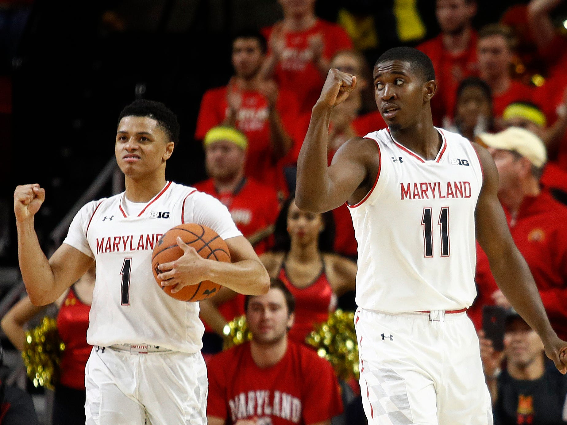 Maryland guards Anthony Cowan Jr. (1) and Darryl Morsell celebrate in the final moments of an NCAA college basketball game against Penn State, Saturday, Dec. 1, 2018, in College Park, Md. Maryland won 66-59. (AP Photo/Patrick Semansky)