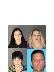 Amanda Lynn Mosed, 38, of New Boston (left), Jodie Beth Welbes, 49, of Lincoln Park, Christopher Bucannion, 45, of New Boston, and Beverly Jo Sassin, 70, of New Boston. (Photo: Dearborn Police Department)