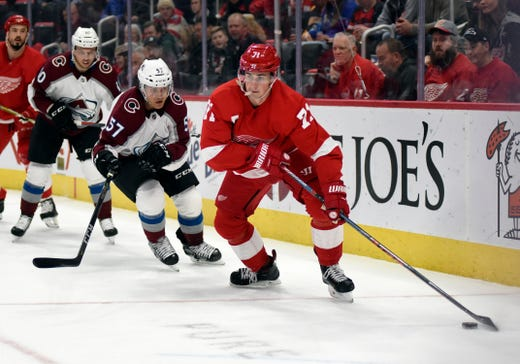 Detroit Red Wings Center Dylan Larkin Right Moves The Puck Away From Colorado Avalanche