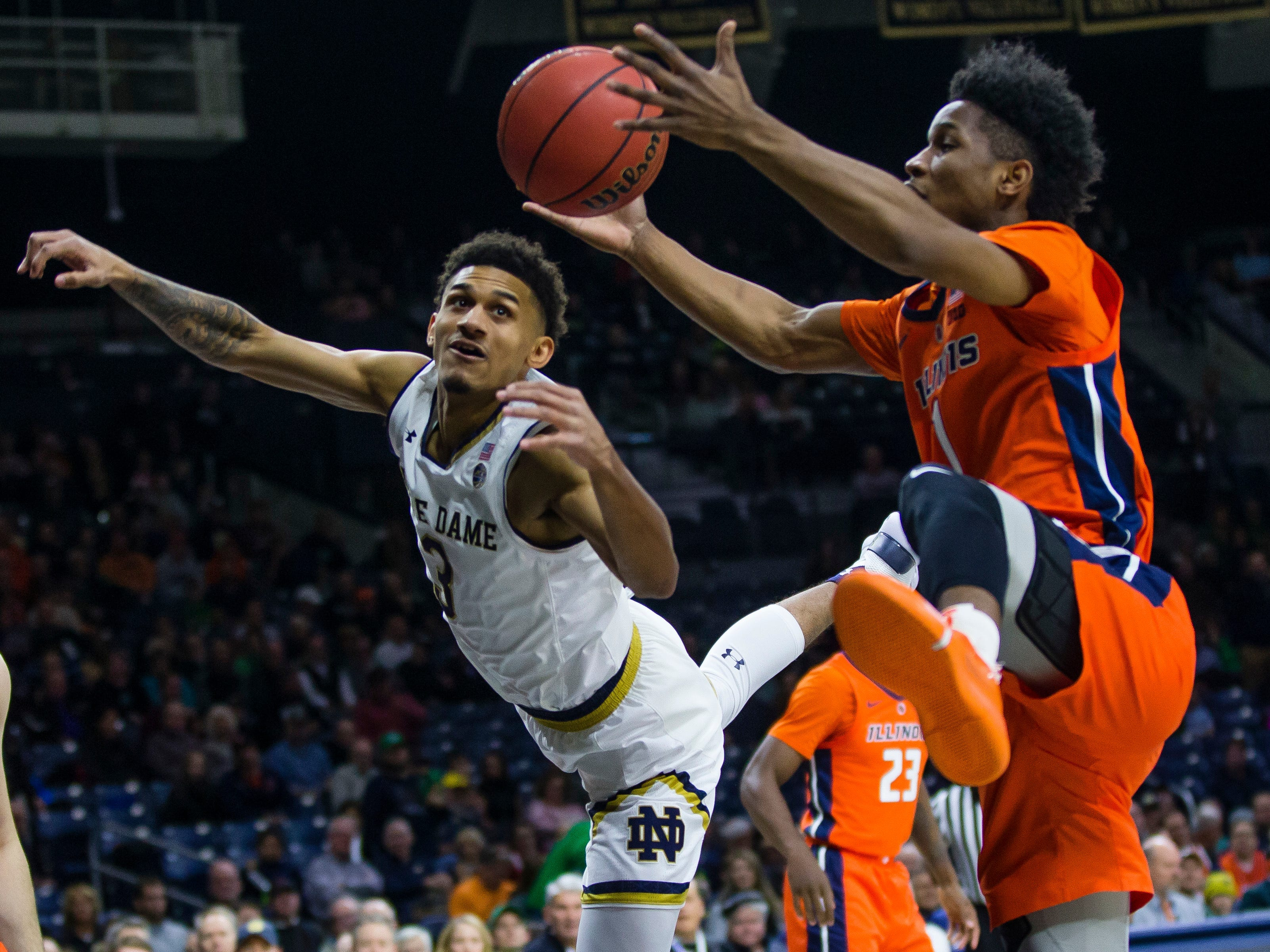 Notre Dame's Prentiss Hubb (3) and Illinois' Trent Frazier (1) fight for a rebound during an NCAA college basketball game Tuesday, Nov. 27, 2018, in South Bend, Ind. (Michael Caterina/South Bend Tribune via AP)