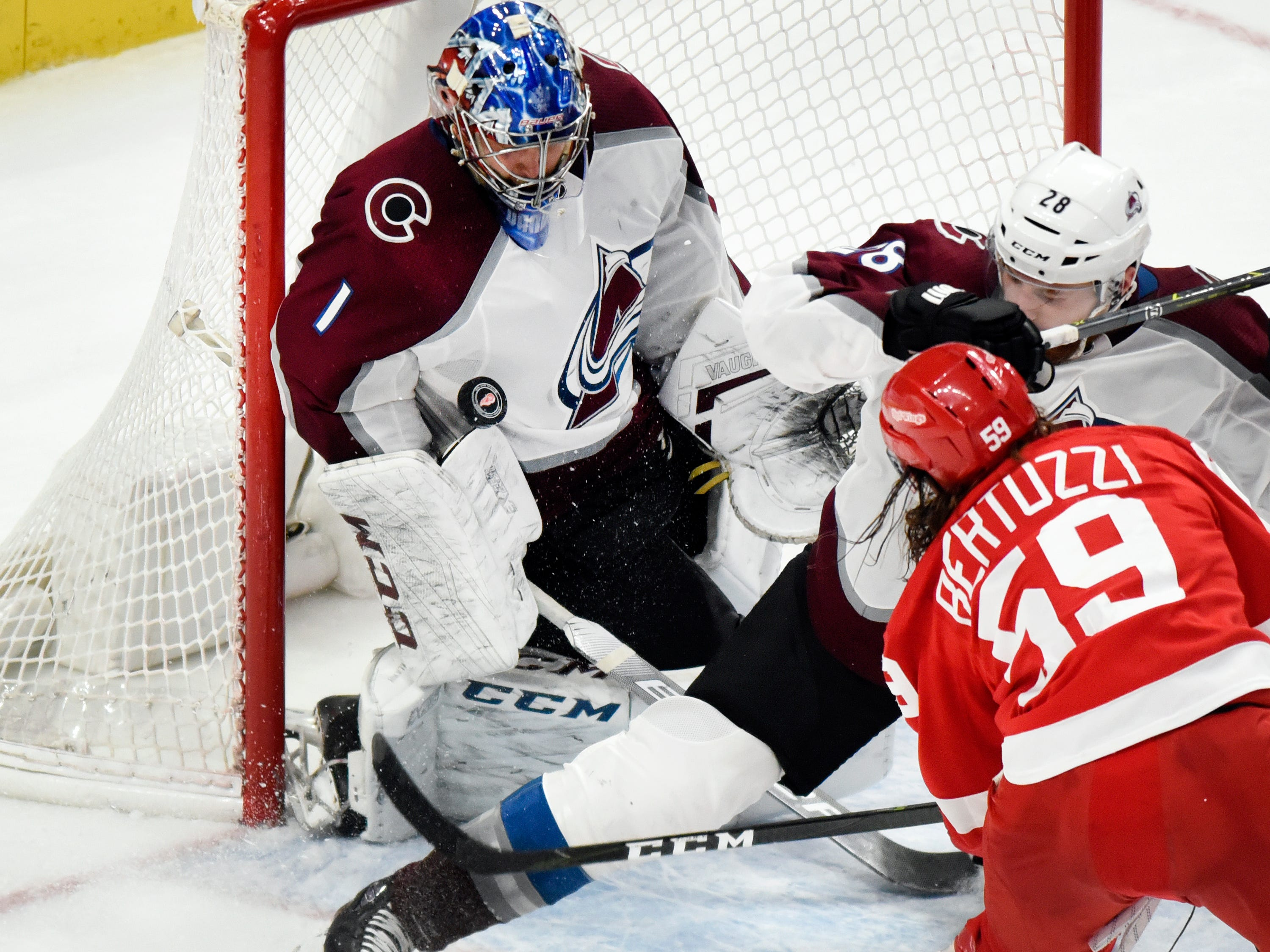 Colorado Avalanche goaltender Semyon Varlamov (1) of Russia blocks the shot of Detroit Red Wings left wing Tyler Bertuzzi (59) as defenseman Ian Cole (28) slides in during the third period.