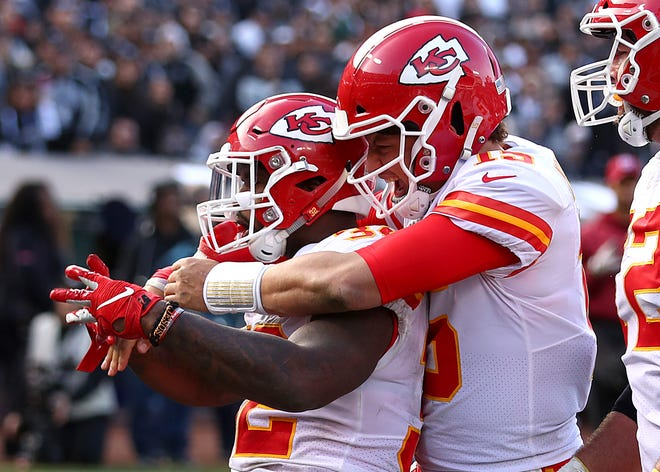 Running back Spencer Ware, left, quarterback Patrick Mahomes and the Chiefs will meet the Lions in 2019.
