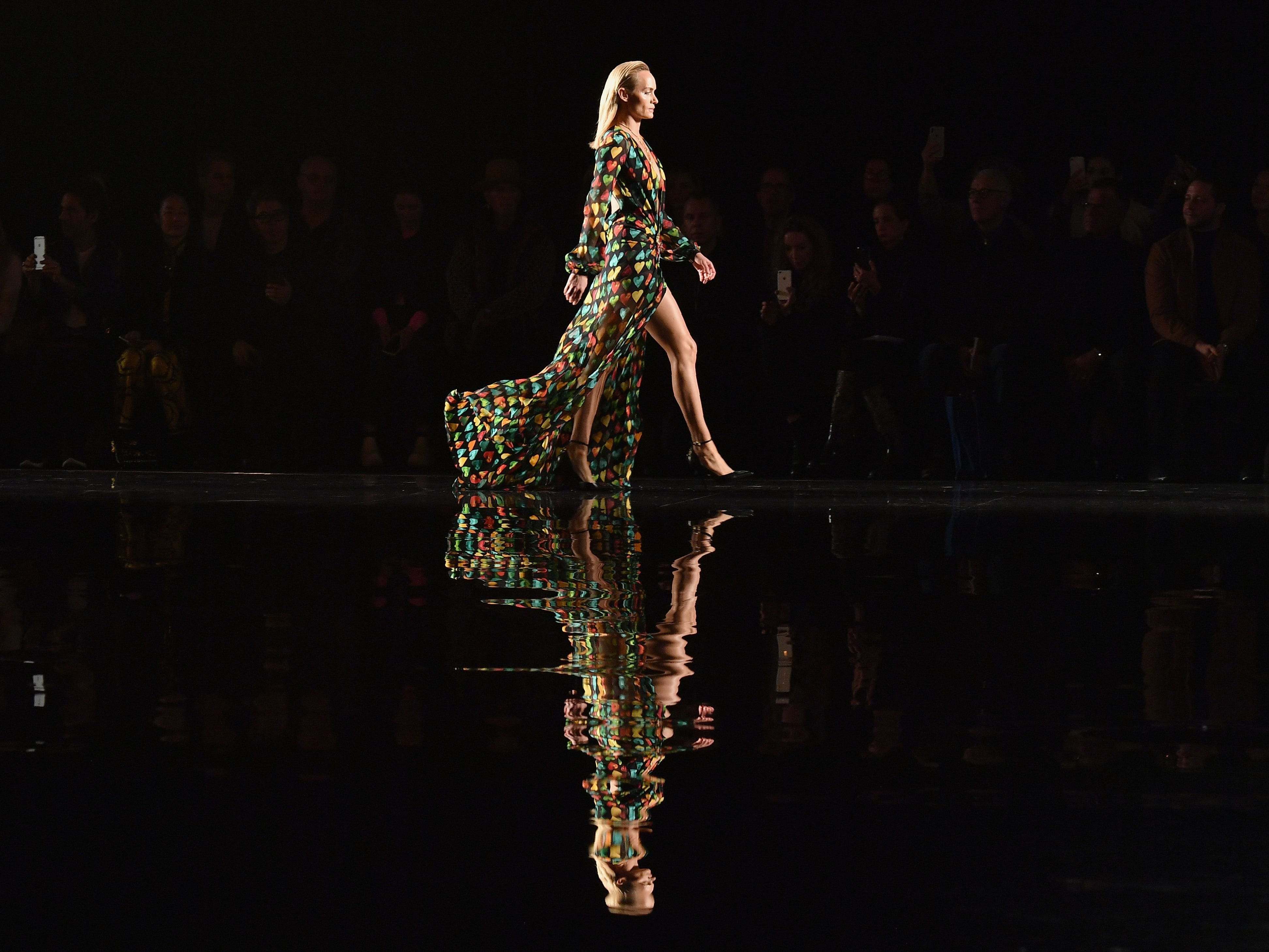 American model Amber Valletta walks the runway at the Versace Pre-Fall 2019 Runway Show on Sunday, Dec. 2, 2018 in New York City.