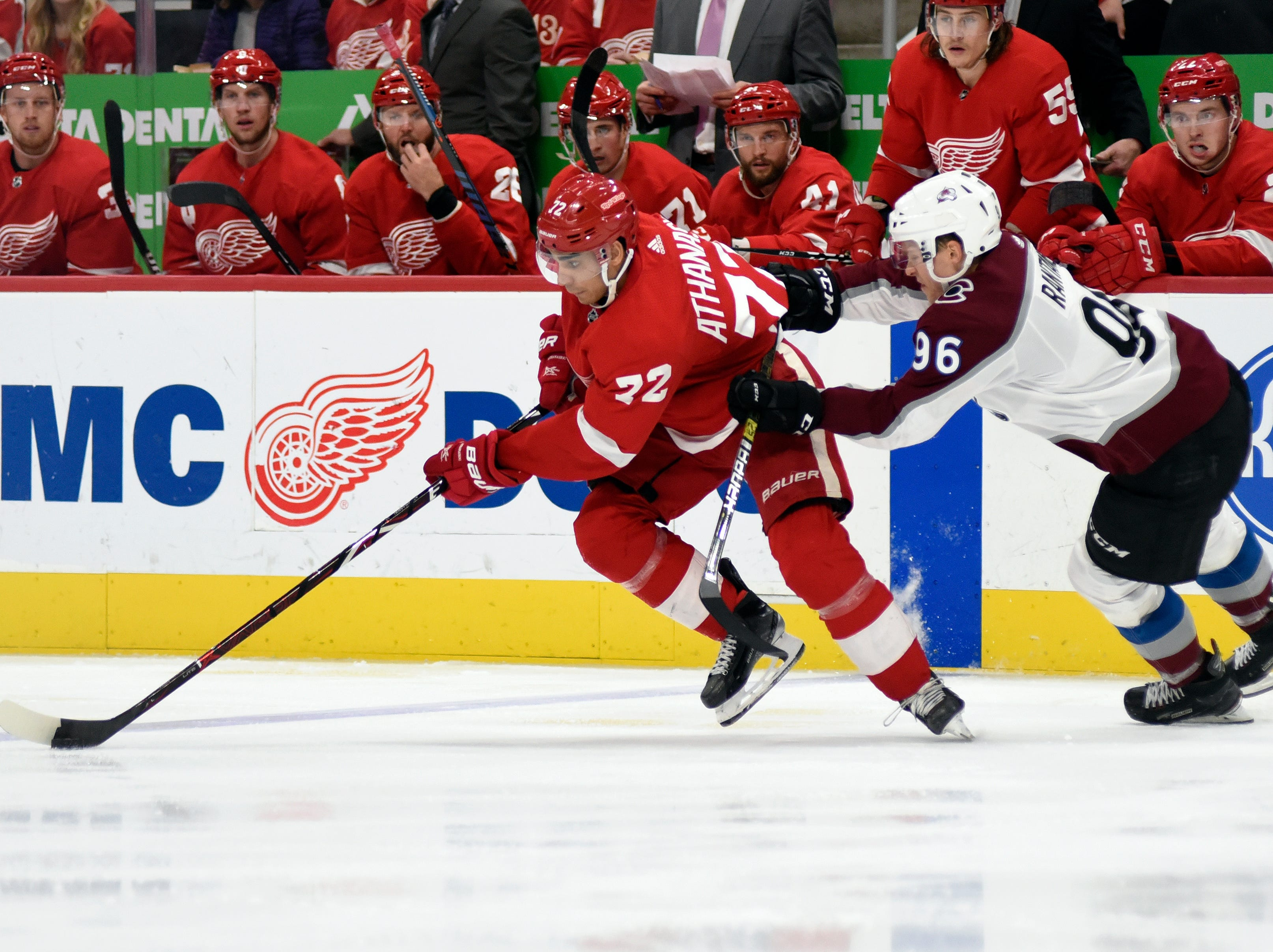Detroit Red Wings center Andreas Athanasiou, left, moves the puck away from Colorado Avalanche right wing Mikko Rantanen of Finland during the second period.